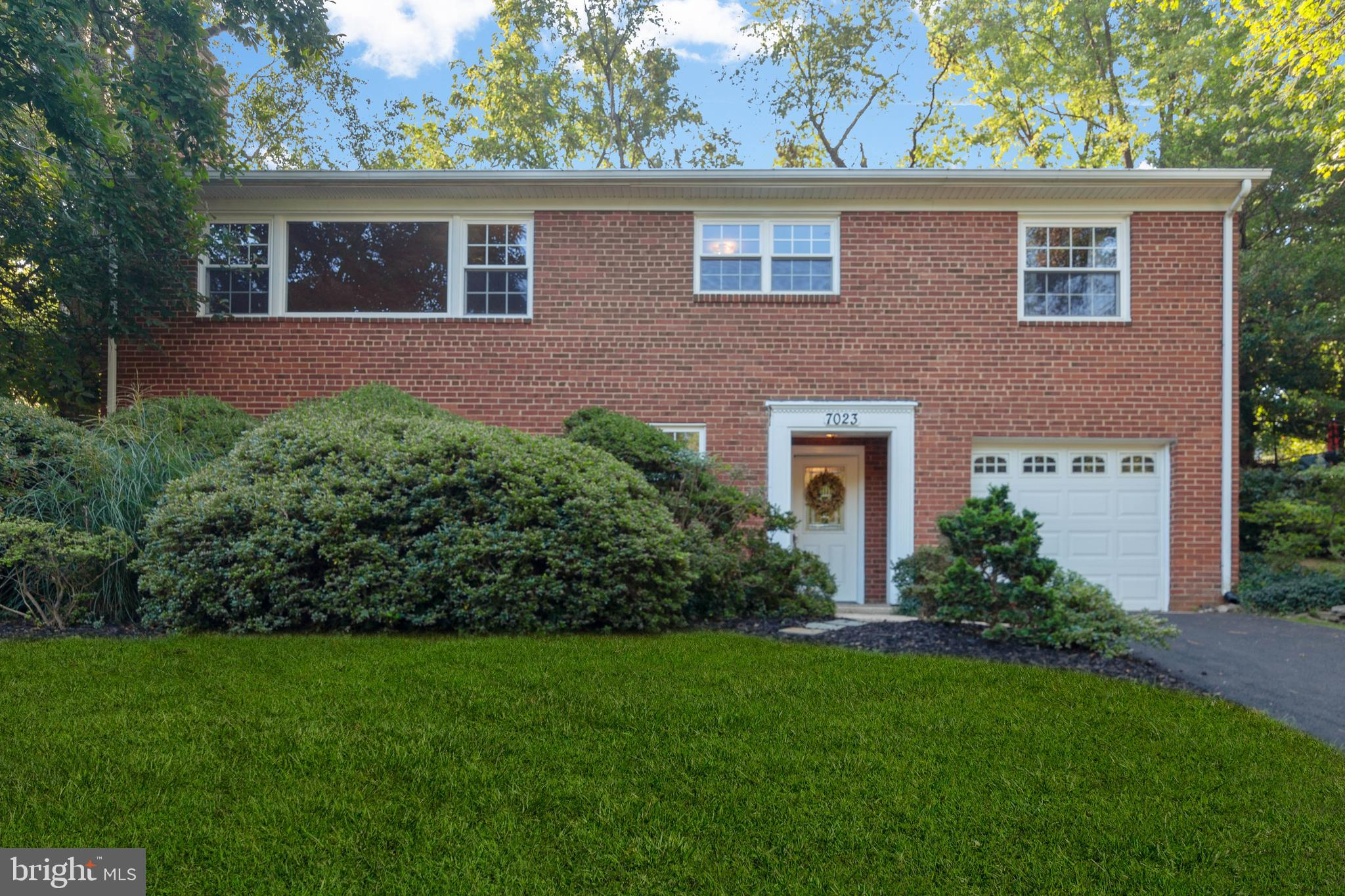 This gorgeous home is move in ready!  New paint, stunning hardwoods, big kitchen, tons of natural light.  Great for entertaining - two fireplaces - amazing screened porch - huge deck - fenced yard!  Newer roof and windows!   Walk to parks, pool, tennis courts, buses, school!