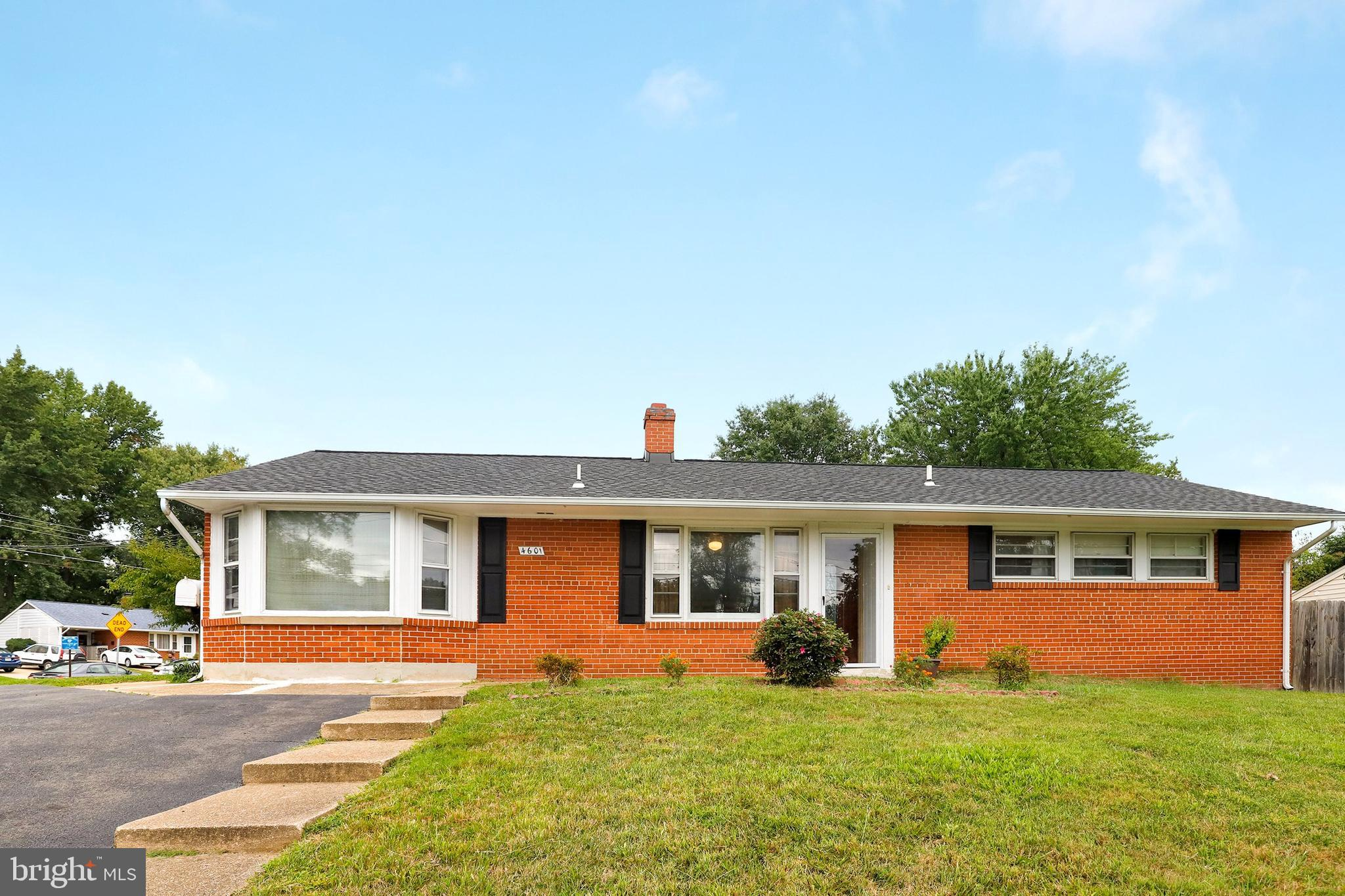 Back on market, buyer got cold feet, not a home inspection issue. Value priced inside the beltway Annandale location close to 395/495, shopping, and restaurants. Sited on a level corner lot, fully fenced with fruit bearing trees.  New roof 2018. Updates in the last 5 years include  kitchen with stainless appliances,granite, glass tile back splash, GAS COOKING, bath, and  laminate flooring in main living area. Expansive living room/dining room space with wood burning fireplace and and brick surround. Plenty of parking in the circular driveway and on street.