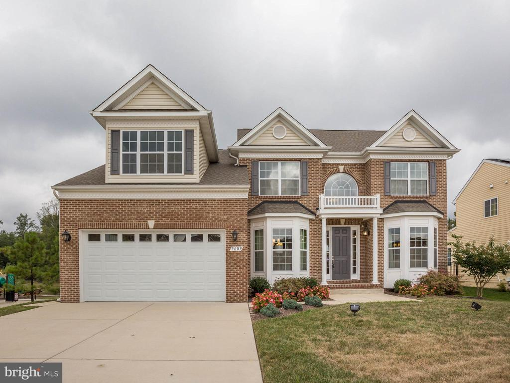 BACK ON THE MARKET!!! Beautiful Model Home in sought after Surratts Crossing Community! Lots of upgrades included: Gourmet Kitchen w/Stainless Steel Appliances & Quartz Countertops; Oversized Owner's Suite & Bath w/Royal Shower & Separate Freestanding Tub; Finished Basement w/Theater Room, Wet Bar, Rec Room, Bedroom & Full Bathroom; Decorative Stone Gas Fireplace in Family Room; Upgraded Trim throughout; Hardwood Floors First Floor; Composite Deck off Morning Room; Surround Music throughout; Buddy Bath; 2nd Floor Laundry and Much More! 15K closing help with preferred lender! ASK ABOUT OUR REALTOR BONUS PROGRAM!