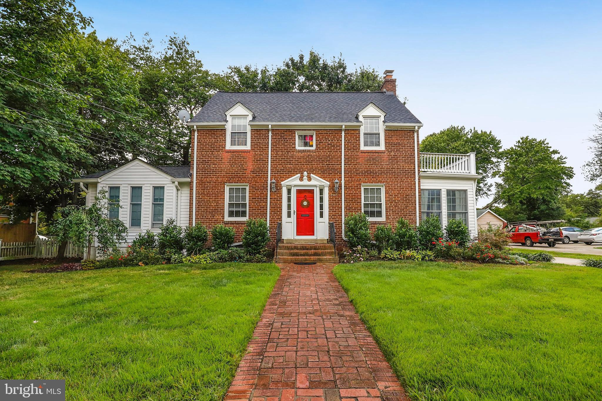 Timeless brick colonial on picturesque .44 acre lot. Artfully crafted with dramatic lighting with medallion accents, crown molding, built-in book shelves and gorgeous original hard wood floors! Pride of ownership is evident, with new kitchen appliances, new sump pump, new water heater, new basement flooring and new roof as of August 2019. The house has been expanded with light-filled additions on each side, keeping true to the classic architecture - one side boasting a main level master bedroom and scrumptious en suite master bath and the other, an adorable sun room! The expansive, level fenced back yard has a deck to host BBQ's and parties! Easy commute to DC, Pentagon, Amazon HQ2 and Fort Belvoir!