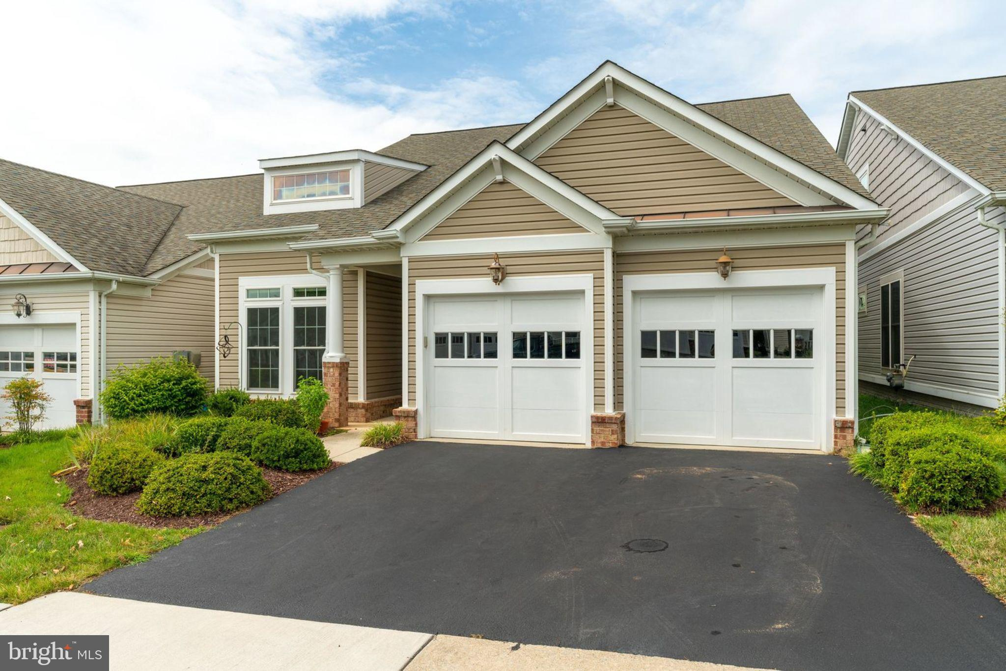 WINTHROP Model in 55+Community - Main Level living at its finest. 3 BR, 3 Full BA, Office, LR, DR Eat in Kitchen, 2 Car Garage.   Driveway sealed in 2019, 2 Yr old Furnace and A/C w/ electronic filter and humidifier. Hardwood floors throughout Main level.  This model has a Sunroom/Florida room w  Tile floor and walk out to Trex type Deck. Eat in Kitchen w/ ceramic tile backsplash, ALL appliances are SS, granite counters and lovely picture window at table area to enjoy the view.Refrigerator and Microwave replaced in last few years. Master Bath has both walk in Tile Shower and Large jacuzzi style soaking Tub. Enjoy this Private Community Clubhouse w/ Indoor Pool, Spa, Fitness rm, Billiards rm, Banquet rm, Social/Activity rm, Dance/Exercise rm, Tennis, Bocci, Tot-Lot and Gardens. Close to I-95, VRE and Ft Belvoir.  Great Home, Great Location!