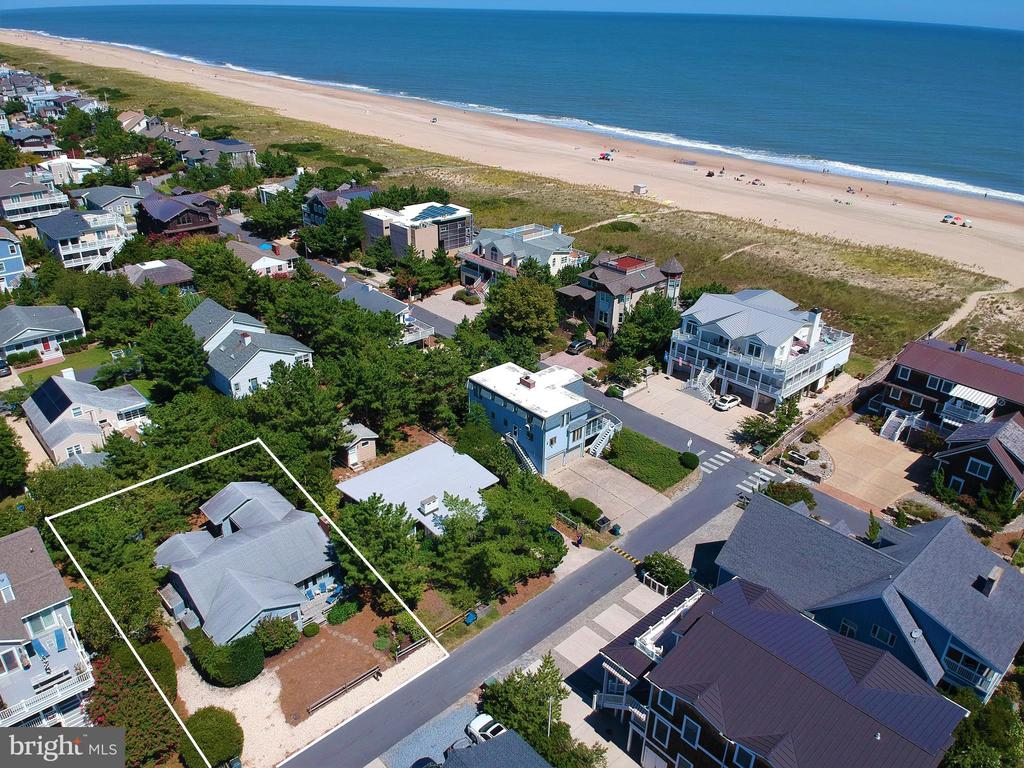 Adorable Oceanblock beach cottage only 3 lots off the Oceanfront in one of the most highly sought after communities on the Delaware Coast. Sussex Shores is in a market of it~s own with a truly private life guarded beach, directly adjacent to Bethany. Just a short easy walk into town, this property is in a prime location at the southern end of the community, tucked away on a quiet one way street. This charming beach retreat offers a sunroom with tile floor, bright living room with brick fireplace, and 3 bedrooms plus a sitting room off the master that could be a 4th bedroom. Positioned on a large 65 x 110 parcel, this property offers plenty of possibilities including renovation or the perfect place to build your custom dream home.
