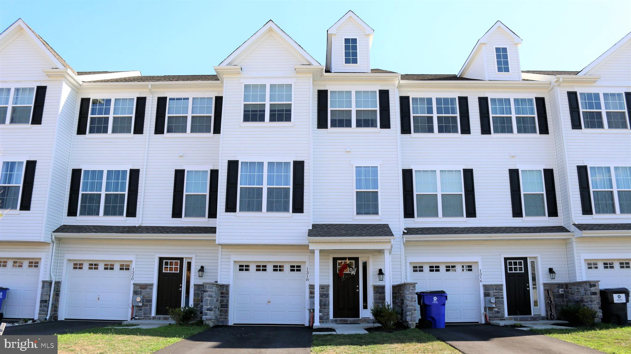Welcome to our listing at 1318 Carrick Ct In Middletown Delaware.  This lovely 3 to 4 bedroom 2.5 bath townhome with 1 car garage located in the appoquinimink school district offers an exceptional value for anyone looking for that hard to find 4th bedroom option under $300k in the Appo school district.  This beautiful home features an attractive exterior including stone veneer accents and classic styling accentuated nicely by 2 front facing peaks to stand out from the other homes in the row.  Inside you'll find a brightly lit foyer leading to a finished basement space which is currently being used as a 4th bedroom as it does have the necessary closet, and if you want to improve on that, there is a plumbing rough in for a full bath.  If you don't need the 4th bedroom and just want a quiet place to hang out away from everyone else, this space is ideal.  On the main level you'll find an airy open concept living room, dining room combo adjacent to a spacious eat in kitchen complete with a center isle/breakfast bar combo, granite counter tops, stainless appliances, and gas cooking.  Upstairs you'll find 2 generously sized secondary rooms, a convenient upstairs laundry,  and a spacious master suite complete with master bath.  This home was built in 2018 so it is a fantastic option if you want the newness of new construction but you want to actually see what you're getting and don't want to wait for the build.  Put this one on your tour today!