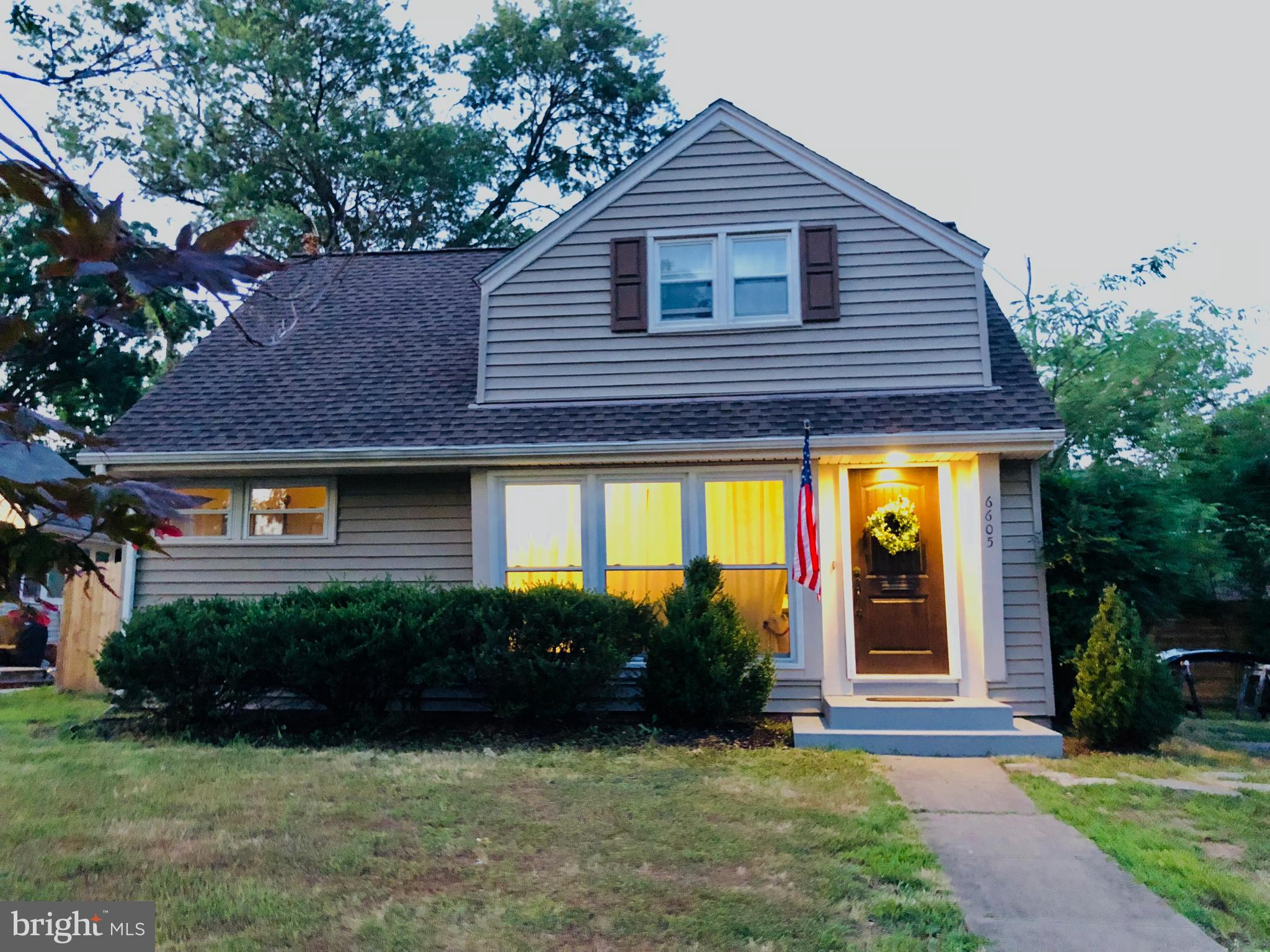 Gorgeous light and bright updated cape cod. 4 brs/2 baths, gourmet kitchen w granite and stainless. Huge living room addition w/vaulted ceilings. Hardwood floors throughout, fresh paint, french doors from living room to deck overlooking rear garden. Walk to Potomac River/Bell Haven. A must see!