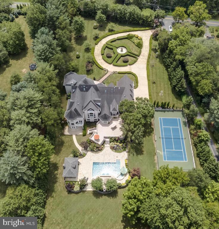 This timeless masterpiece was redesigned, expanded by 15,000 square feet, and constructed in 2006 with major updates in 2019.  Owner/Architect designed, magnificent 18,000 square feet, Chateau style custom estate, set on approximately 3 privately gated acres, lush professionally landscaped grounds, water features, 60 zone sprinkler system, outdoor lighting, resort living & grand entertaining. Embassy sized rooms, dramatic entry with custom hand-painted iron curved staircase, 9 bedrooms, 8 full baths, 5 half baths, 9 Custom fireplaces, elevator, chestnut wood study, Chef~s state-of-the-art kitchen. Light-filled lower level- Temperature controlled wine cellar, theatre, gym, wet bar, LL ladies and gents restrooms, catering kitchen, Maid's quarters. Outdoor living- two outdoor kitchens, 2 outdoor fireplaces, outdoor saltwater pool & Jacuzzi, Tennis court, Cabana, Outdoor full bath. Generator. 4 car garage, Separate entrance to future loft apartment/multi-use space above the garage. All of this in the heart of Great Falls Virginia, a stroll to River-Bend Golf and country club, hiking trails, horse riding center, Potomac River Falls, Parkland, minutes to Dulles, Regan National and Downtown D.C. Driving distance to the Plains, ski resorts, wineries, and horse country all in the foothills of the Blue Ridge Mountains.