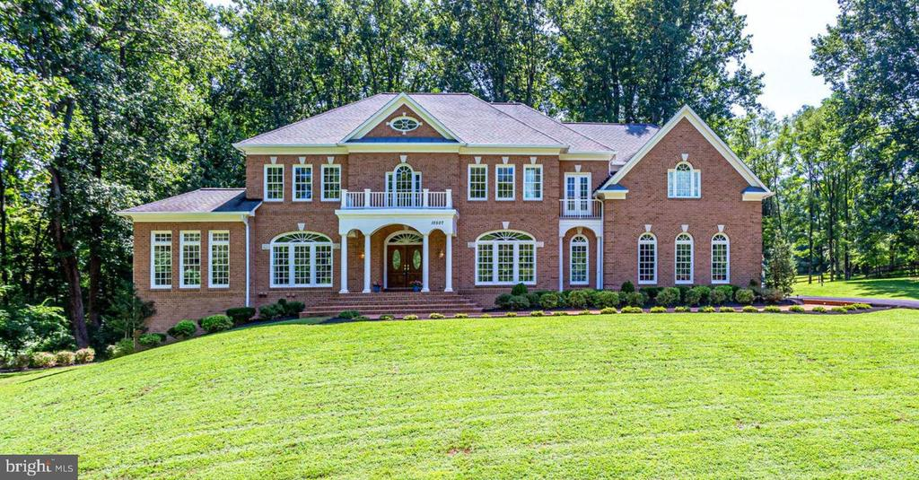 Magnificent Michelangelo Renaissance Build w/ all Brick Exterior, 4 Car Garage, Open Floor Plan, Thoughtful Upgrades throughout, Vaulted & Tray Ceilings & Custom Windows/Molding. Almost 10,000 Sq Feet on 3 Finished Levels on 2+Acre Private Lot. Wood Floors throughout Main Level/Master BR/Upper Hall, Gourmet Kitchen w/ SS, Granite, Island & Bar open to Windowed Eat-In Kitchen & Sitting Room. 2 Walk-outs to New Trex Deck w/ Custom Lighting & Walk Down to Yard. Great Room w/ Ceiling to Floor Windows, Upgraded Stone Gas Fireplace. Upper LevelBoasts 5BR & 5 Full Baths including Suite with separate staircase entrance.Master Bedroom includes Sitting Room w/ Gas Fireplace, Private Balcony w/ Tranquil View, Den, Rough-In for Bar/Breakfast Area, Master BA w/His/Hers Vanities, Soaking Tub & Sep Glass Enclosed Shower, 2 CommodeRooms, His/Hers Combined & Individual Walk-in Closets. Upper Bedrooms are generously sized & have Private Ensuite Baths. Walk-outLight Filled Lower Level includes Family Room w/ Gas Fireplace, Bar, GameRoom, Theater, 2 Bedrooms, Bonus Room & Full Bath. Upgrade to 10 Ft Ceilings on Main Level and 9 Ft Ceilings on Upper/Lower Levels. Custom Molding, Spiral Staircase & second back Staircase, Neutral Paint & Carpet Throughout. Turn Key, Move-In Ready, Meticulously Maintained & Exceptional Value! Tranquil Setting yet only Mins to Modern Conveniences.