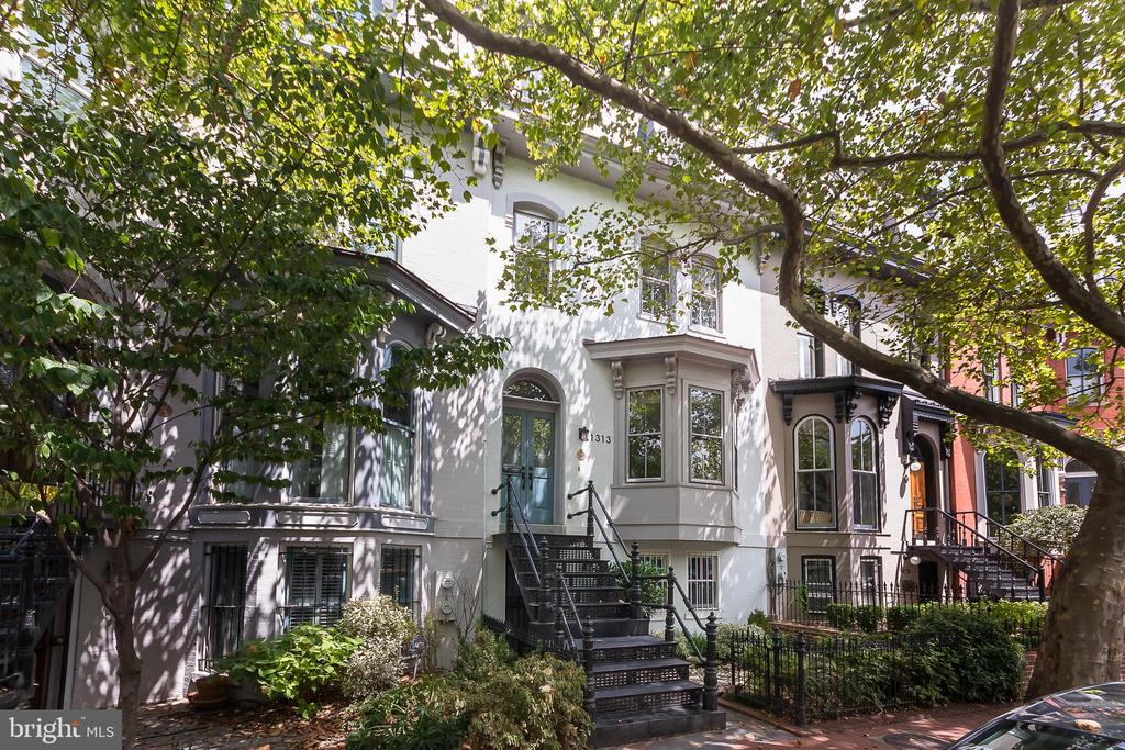 Stunning victorian on one of Logan's most beautiful & coveted blocks. Light pours through the gorgeous bay windows. High ceilings, arched doorways, hardwood floors, exposed brick on staircase & Mors~ wood burning stove. Wonderful entertaining space in large living & dining rooms. Bright and airy kitchen with maple cabinets, granite counters, stainless appliances, cozy sitting area & skylight. Tranquil & zen backyard is a perfect oasis from city life as well as doubling as off street parking.2nd floor consists of two nice sized bedrooms and full travertine bath. Gorgeous 3rd floor master suite has built-ins, enormous walk-in closet with new Bosch washer & dryer and wonderful master bath with soaking tub, separate shower and skylight.Lower level legal rental unit is comprised of a generous living & dining room, galley kitchen, bedroom, bath and its own washer and dryer. Located in the heart of Logan Circle this incredible home is virtually steps away from numerous restaurants, shopping, galleries & theaters. Easy walk to Metro.