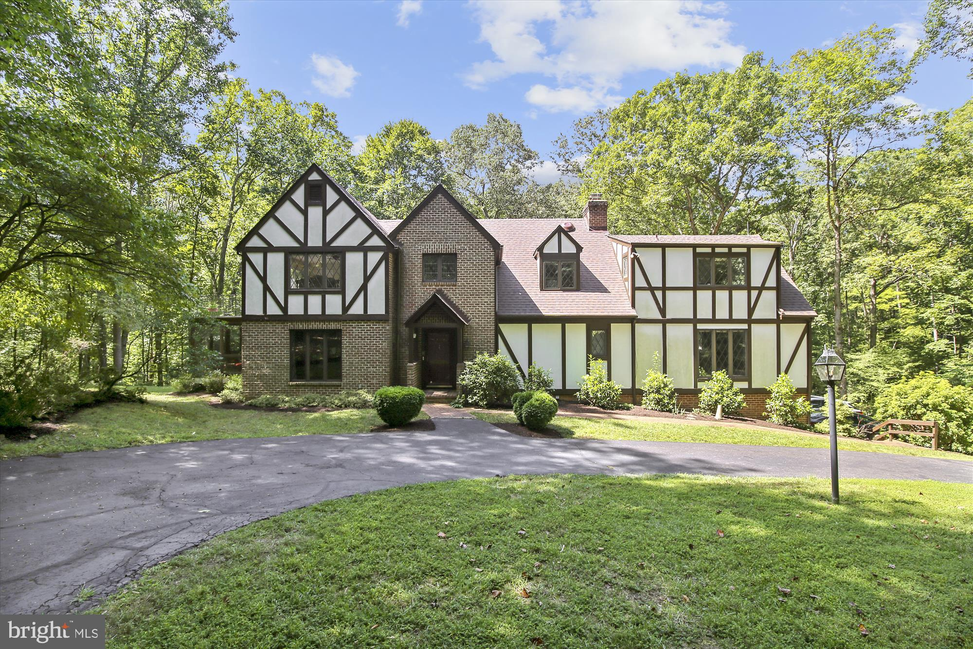 Custom 1-Owner Tudor on Private Treed 5-Acre Lot in The English Hills Estate. *****Fabulous Main Level with Abundance of Living/Entertaining Space, including Eat-In Kitchen, Family Room with Fireplace, Sun Room with Fireplace, Office with Built-Ins, Living Room with Fireplace, Dining Room and 2-Story Foyer. *****Owner's Suite with Private Balcony, Walk-In Closet and Ensuite Bath with Double Sinks, Shower and Separate Tub. *****Large Secondary Bedrooms and Laundry Room on Upper Level. *****Finished Lower Level with Den/Guest Room and Full Bath. *****Amazing Screened Porch with Cathedral Ceiling on Main Level with Walk-Out to Deck. *****New Asphalt Architectural Shingle Roof Installed Aug 2019. *****Hardwoods, Elegant Moldings, 3 Gas Fireplaces, 2-Zone Heat/AC, Natural Gas, and Generous Closet/Storage Space. *****Gated Entry, 2-Car Garage, Circular Front Driveway, Generator, Shed. *****Great Bones -- Keep Your Eyes on the Prize! ****CLICK VIRTUAL TOUR ICON FOR TRUPLACE PHOTO TOUR WITH FLOOR PLAN! *****Property Conveys As Is.