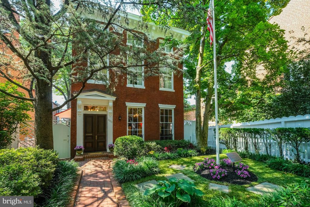 Elegant detached Georgetown residence featuring historical architectural details, combined with modern amenities and systems. The main level includes a gracious foyer, light-filled formal living room with 8~ windows and a fireplace, library or office with a fireplace, formal dining room, and an eat-in kitchen with an exposed brick wall and breakfast area. The second floor has a spacious master suite with a fireplace and luxurious bathroom with separate sinks, walk in shower and footed tub. Dressing room or additional bedroom, office, full bath and sitting area. The third floor includes a guest bedroom with ensuite bath. The lower level has a family room with wet bar, two additional bedrooms, a full bath, a half bath, and a laundry room. Lastly, the home has beautifully landscaped front and rear gardens and two car parking!