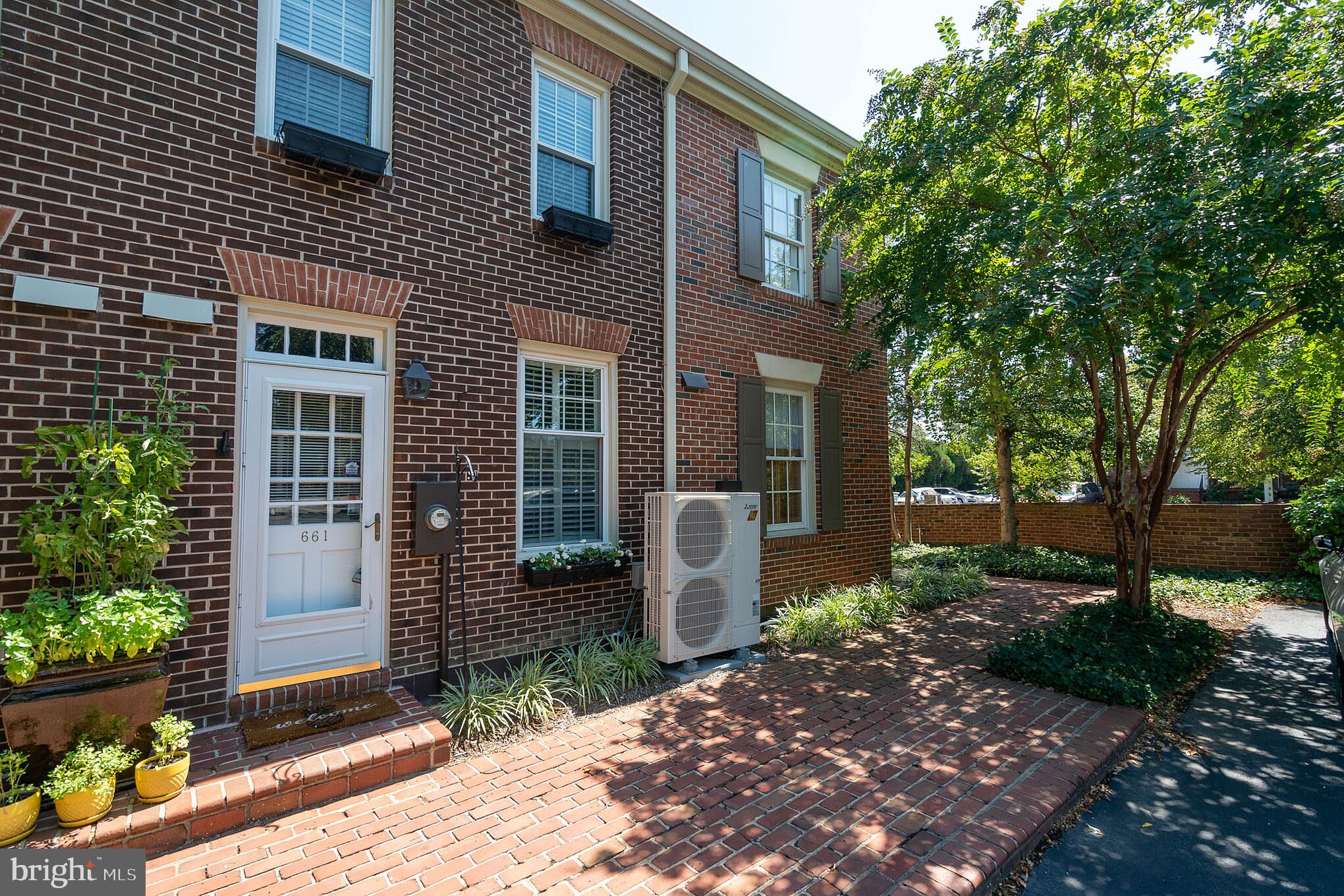 **GREAT Location with 2 off street parking spaces**Excellent condition** 3 finished levels**All brick TH/Condo style living with private brick patio /courtyard setting**Update kitchen and bathrooms**On  trend colors throughout**Cozy Fireplace**New in 2019 HVAC System and 2nd bathroom**Convenient to shopping, restaurants, metro and commuter routes and more!!!!