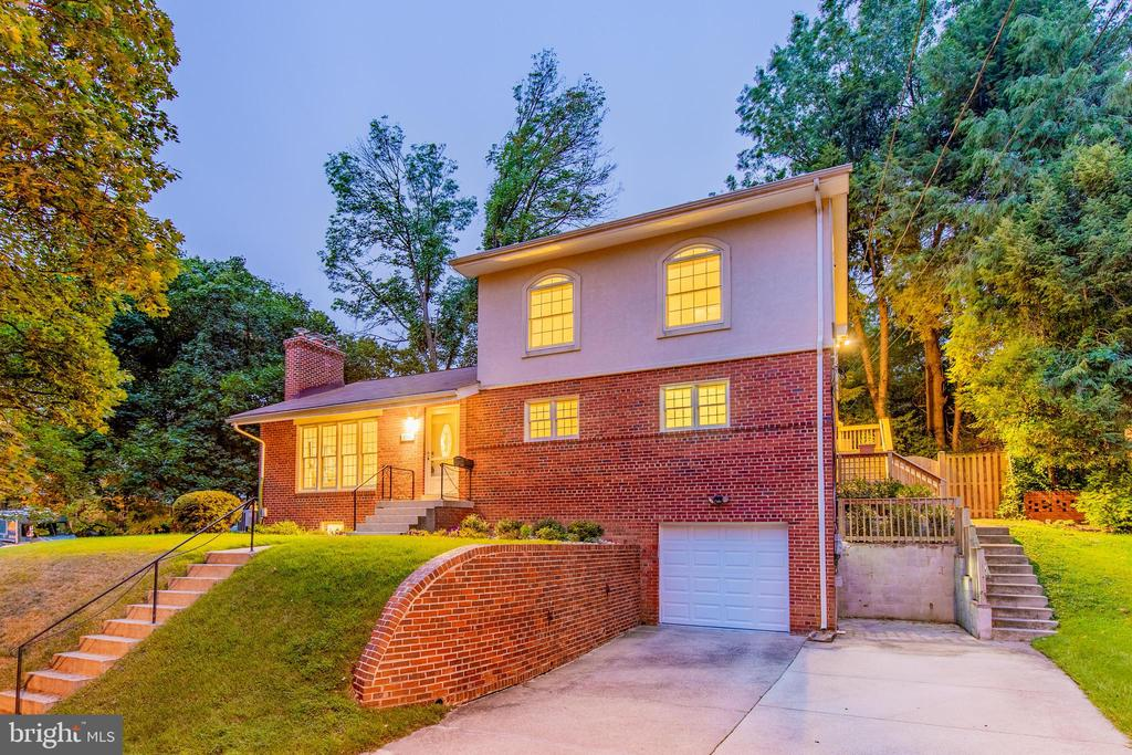 A gem located right inside the beltway, next to NIH and less than 5 minutes from downtown Bethesda, this Parkview home is ready to wow! As you enter, youre instantly greeted by a large family room drenched in natural light from oversized windows, complete with a brick fireplace. A free-flowing adjacent dedicated dining room opens into a modern kitchen featuring designer backsplash, glass cabinet inserts, stainless steel appliances and access to a private  backyard patio. A first level masters retreat includes an ensuite bath with double vanity and tasteful finishes plus an expansive walk-in closet; shopaholics rejoice!  Upstairs, move-in ready bedrooms enjoy a centrally located living area and wet bar for added convenience and an updated full bath. A fully finished lower level has plenty of recreational space for entertaining with the added bonus of an additional oversized bedroom and full bath. Electric car charging port in driveway! Located just minutes from downtown Bethesda, Kensington and North Chevy Chase, this homes comfort, convenience and charm is sure to delight! Welcome Home!