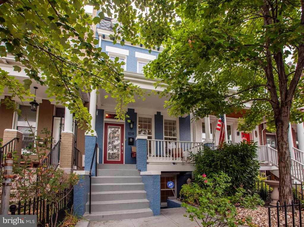 This beautiful professionally renovated row house features two levels for the main living space and a third basement level with exterior access. The front elevated porch overlooks a quiet and green landscape. The main and upper levels have hardwood floors throughout, gas fireplace, and an open floor plan. The large living room flows well into the dining room, half bath and laundry closet, and kitchen with breakfast room. From the breakfast room you can move directly to a private entertainment deck overlooking the backyard and inviting hot tub. The garden area leads to the separate garage. Upstairs there are three bedrooms and two bathrooms. The master suite is bright and spacious with a master bath.  The rear bedroom has a private balcony overlooking the back yard. The basement unit has one bedroom and one bathroom. There are two separate entrances (front and rear of building) with ample ceiling height.  The floors are tiled throughout. The basement unit has a certificate of occupancy and is currently vacant. This row house is well situated at the heart of H Street corridor, short walking distance to NoMa-Gallaudet U New York Ave Metro Station and Union Station Metro Station, several shops, restaurants, and parks.