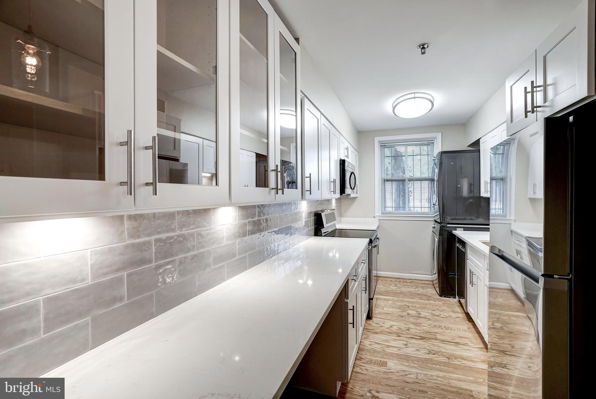 Welcome home to this remodeled, elegant condo in the historic Swann-Daingerfield building built in 1802.  This exclusive Victorian building is located in the heart of Old Town, & was recently added to the National Register of Historic Properties.  Step through your private entrance to a large living room featuring a cozy wood burning fireplace, charming built-ins, gleaming hardwood flooring, with plantation shutters throughout.  You~ll find additional built-ins in the dining room, along with stunning French doors that open to a lovely, brick patio.  The gourmet kitchen features upgraded quartz countertops, custom cabinetry, & Energy Star stainless steel appliances.  Retreat to a spacious master bedroom with stunning en-suite.  Both bathrooms have been updated with modern vanities, tile and fixtures. This unit is just a few short steps from the tranquil gardens and courtyard featuring a magnificent magnolia tree. Small pets are allowed in this wonderful, inclusive community! Leave your car in the assigned parking spot (#5), & enjoy a short stroll to the restaurants, unique shops, and farmers market on King Street, as well as the Potomac River, which is just 7 blocks away. It is a comfortable 14-minute walk to the King Street metro station, and only a seven-minute drive to Washington, DC.  Finally, a large secure storage unit is included.  Welcome home!