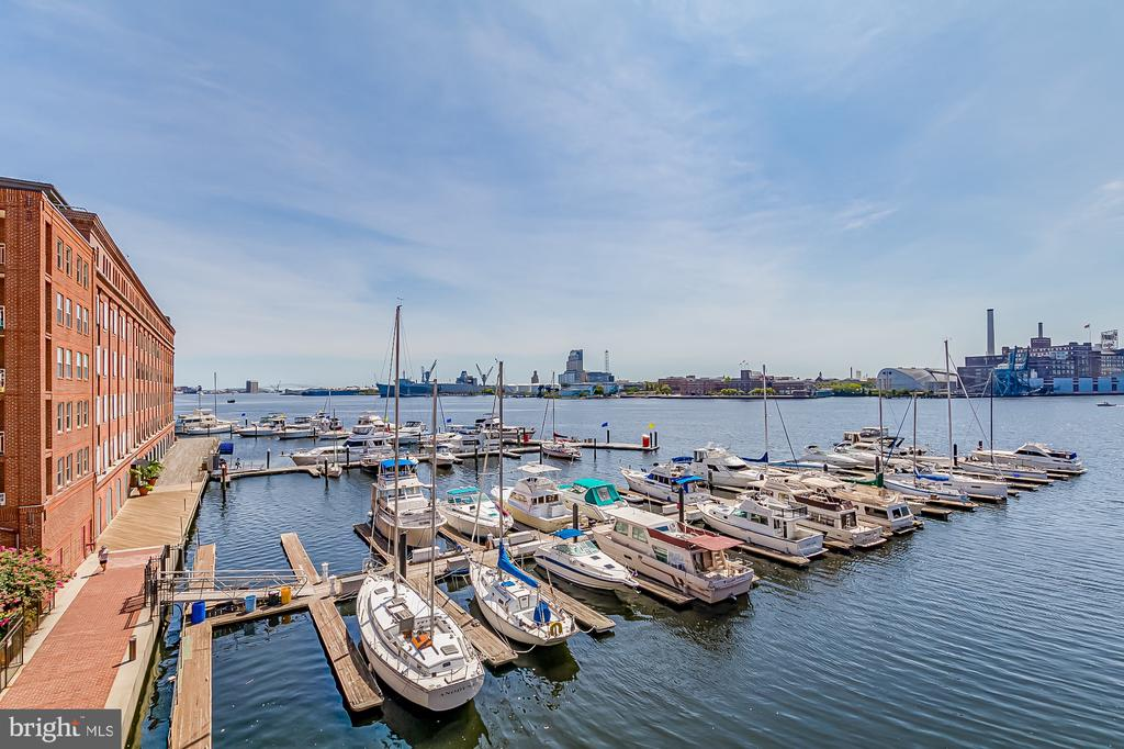 Reduced price on this dream home for quick a quick sale.  It is a lifestyle. Hidden away on a pier in historic Fells Point. A one of a kind modern industrial renovation. Watch the boats & sunsets from nearly every window in the home or the balcony. Step out your front door onto the water front promenade and cobble stone streets of Historic Fells Point. Inner Harbor life does not get better than this. Rare, one of a kind, end unit, water front, pier home in the heart of historic Fells Point.  Loaded with high end finishes.  Built for entertaining while you cook, relax by the fireplaces, and gaze at the bay.  All the custom touches you can imagine, even some you never thought of.  Dream kitchen with 326 cubic feet of interior cabinet space, Blum bifold cabinets, soft close doors, and cabinet lighting.  Custom poured concrete kitchen island has built in USB outlets, 8 electric outlets, built in two zone wine / beverage fridge (Avantti dual zone)Island Range Hood, the list goes on and on.  Poured and heated concrete floors thru out.  Large walk in custom closets, even a fireplace in the master bedroom.  Japanese soaking tub, bidets in all bathrooms.  All high end Samsung appliances, new dual zone HVAC,  new high end windows, many smart home features, the list truly goes on and on. 24h door man, security, package receiving, Unobstructed harbor view from 75 percent of the windows.  Inner Harbor living does not get much better than this.  Truly living on the water.  Doc slips available in front of your home.  The Pendry, restaurants, museums, bars, water front promenade, are all seconds away.