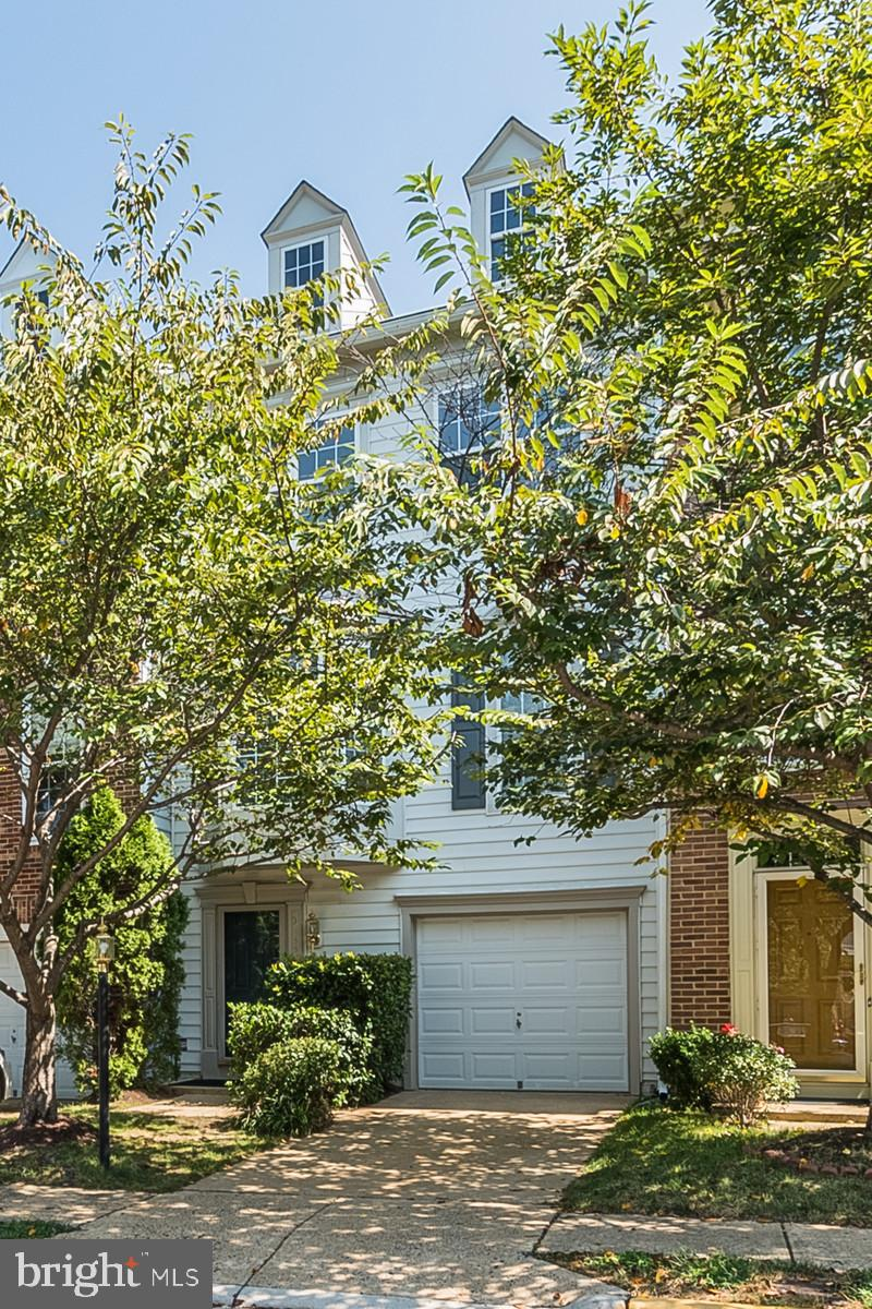 Don't Miss out on this awesome town home. This home has additions on all 3 levels. The wood floors and carpet are brand new and gorgeous! There is so much living space. The main level offers a den/library that has been used as a 3rd bedroom. The home is sunlight throughout. Newer washer and dryer, Roof replaced 2014, Updated kitchen with stainless appliances and granite, New A/C 2012, updated bathrooms. Newer deck and fence. This home is ready to move into!