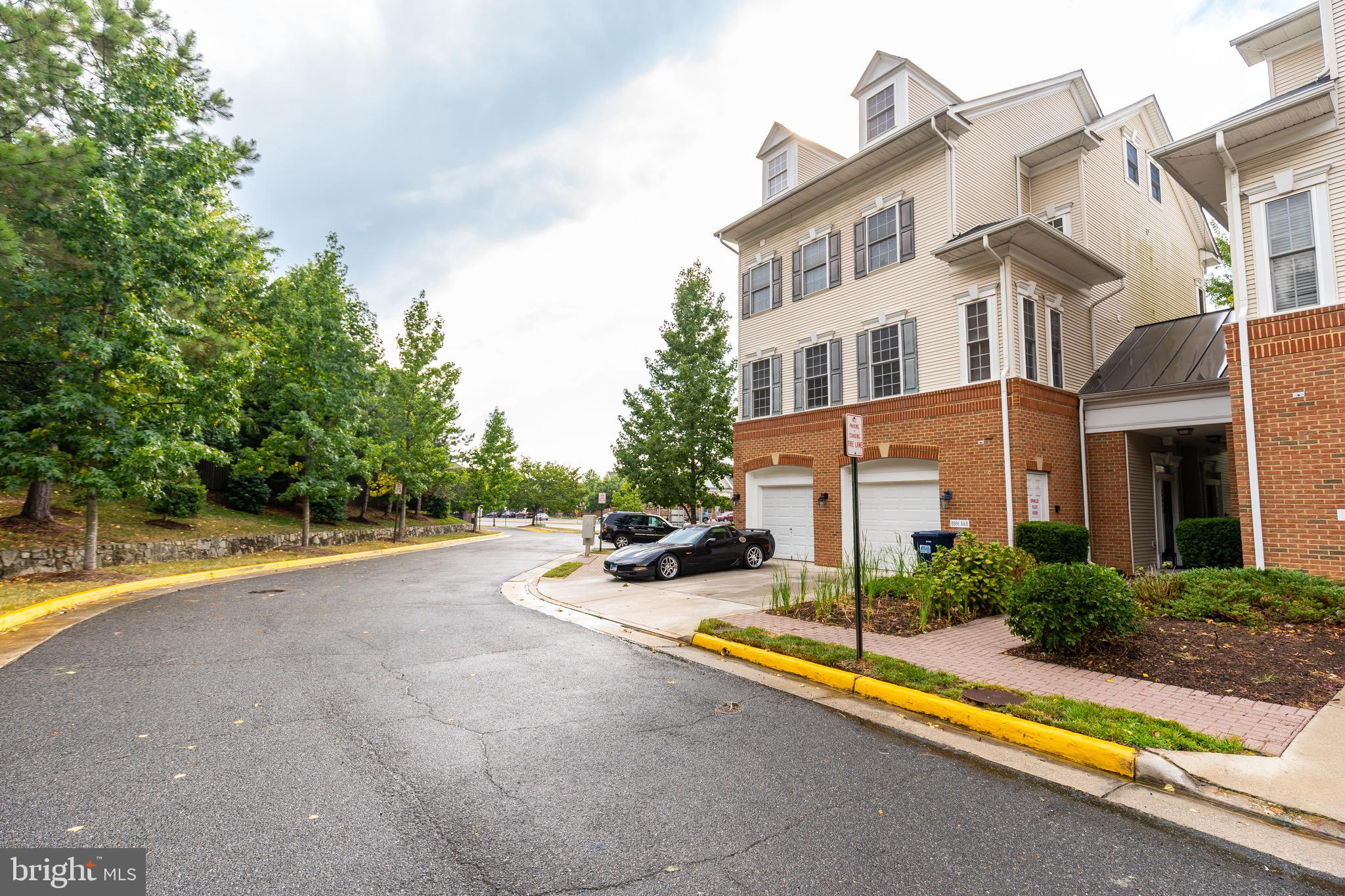 This beautiful 3 Bed + Den, 2.5 Bath, 3 level end-unit townhome is a commuter's dream; within walking distance to Lorton VRE Station and town center, with easy access to I-95! The home boasts an open plan, entry level living space with hardwood floors, high ceilings, fireplace, dedicated dining area, and gourmet kitchen, featuring granite countertops, stainless steel appliance suite, and ample storage. The master bedroom features ensuite bath with, double vanity, two-person soaking tub, and separate shower. Two additional large bedrooms and den occupy the top floor with excellent light and storage. Side by side, front loading washer and dryer in unit, plus attached garage with room for additional parking in the driveway!