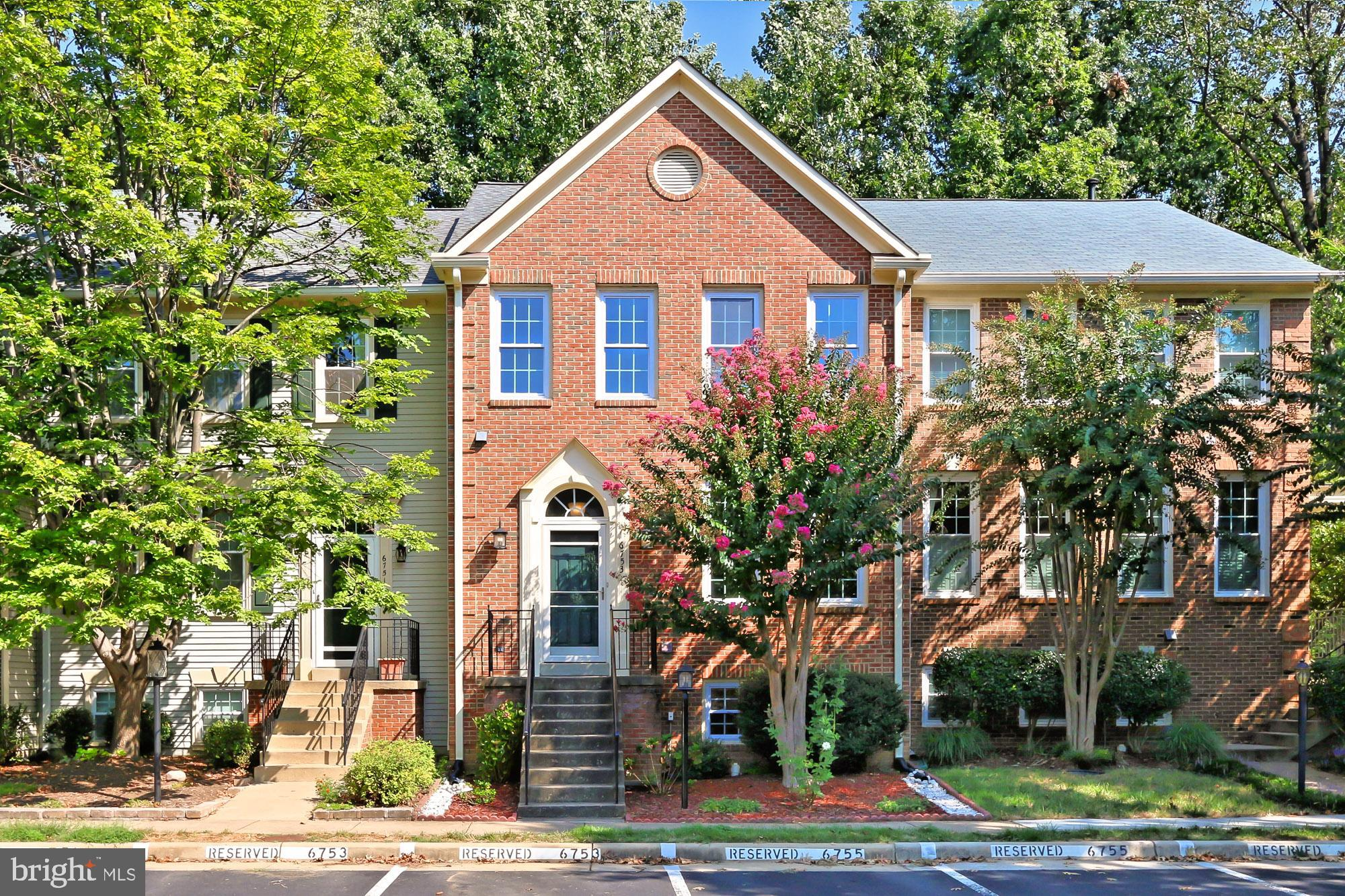 An amazing opportunity to own this very desirable home in a fabulous community; welcome to 6753 Royal Thomas Way in Alexandria, Virginia! Sellers have invested more than $60k in the infrastructure of this home to include a new roof w/architectural shingles in 2016, premium oversized Thompson Creek gutters and guards in 2017, new gas hot water heater and new sump pump in 2018, new top of the line windows and doors in 2016, and so much more...Nestled on a quiet cul-de-sac, this beautifully updated, meticulously maintained 4 bedroom, 3.5 bath Saybrooke model townhome offers plenty of interior living space and a peaceful backyard sheltered by majestic woodland for ultimate privacy. A stately brick facade, sundeck, flagstone patio, open floor plan, warm floors, high ceilings, crisp moldings, and an abundance of new windows (2016) are only some of the reasons this home is so special. A gracious master suite, 3-level bump out addition, and a fully finished lower level create instant appeal, as loving maintenance makes it move-in ready. Rich-toned flooring greets you in the foyer and usher you upward to the living room where 2 windows bathe the space in natural light and illuminate crisp crown molding and a soft neutral color palette. The adjoining dining area with space for all occasions echoes these design details and is accented by chair rail and a contemporary drum light. The sparkling kitchen with is sure to please with newer gleaming granite countertops, an abundance of pristine 42~ cabinetry, and quality stainless steel appliances~including a gas range and a new French door refrigerator. An angled peninsula counter provides an additional working surface and extra seating, as recessed lighting provides a stylish finish touch. Neutral flooring spills into a sun-drenched breakfast area ideal for daily dining in front of big windows with wooded views and a glass-paned door opening to a spacious sundeck; while the cozy family room is bathed in natural light and sure to be