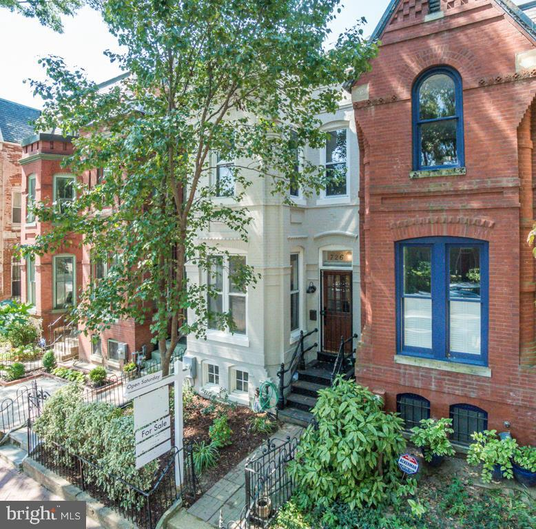 This inviting and spacious row house was thoughtfully renovated in 2018 and boasts a superior location just steps from popular H Street. The gourmet kitchen is tastefully appointed with ample cabinet space, stainless steel appliances and a ideal sitting area. An open living space with hardwood floors and a fireplace, a spacious dining area and a half bath complete the first floor. The upper level includes a large master suite with en-suite bathroom and a large walk-in closet, as well as two guest bedrooms and another full bathroom. The lower level offers a relaxing recreation area or in-law suite, complete with another kitchen, large living room or bedroom and full bathroom. A beautiful and private back deck makes the perfect setting for alfresco entertaining, and leads to 2 off street parking spots. Walking distance to Eastern Market and H Street retail, including Trader Joe~s and Whole Foods. Walking distance to Metro (Orange, Blue, Silver) and Union Station.