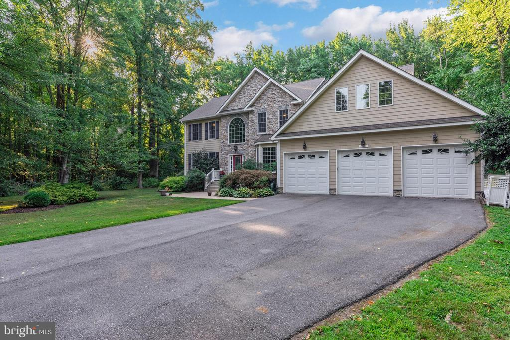 Welcome to 1903 Blue Waters Farm Ln, a luxurious custom-built home situated on a large 2.5 acre lot with expansive wooded views. This is one of only nine homes in the secluded community of Blue Waters Farm. The neighborhood features a pier with water access to Cornfield Creek. Across the street is an exclusive entrance to John Downs Memorial Park, giving you year-round access to miles of walking trails, summertime concerts, a fishing pier, dog beach, and scenic views of the Chesapeake Bay. Enter through the grand foyer into the main floor, featuring a gourmet kitchen with top of the line stainless appliances, granite countertops and a huge island with breakfast bar. The floor plan flows into a formal dining room, a huge two-story living room complete with a gas fireplace, and outside to a brand new composite deck. You~ll love entertaining in this space with friends and family or simply relaxing outside while enjoying the peace and quiet of your private lot. Also located on the main floor is the perfect in-law or au pair suite, which includes a bedroom, full bathroom, and a sitting room with another gas fireplace. Upstairs are four more bedrooms, and three full baths, including your new master retreat. This massive room features a 3-sided gas fireplace, luxurious glass enclosed shower, and a jetted soaking tub. Just one mile up the road you~ll discover the gated causeway to Gibson Island, one of the most treasured spots on the Chesapeake Bay. Members of the Club can take full advantage of the Island~s exquisite terrain and abundance of amenities, including casual and fine dining, an award-winning nine hole golf course, a full service Boat Works facility, multiple tennis courts, a fully equipped fitness center, large swimming pool, and much more. The home also includes a whole house generator, owned propane tank, updated HVAC and a 2,000 sq. ft. unfinished basement with rough-in and separate entrance. So if you~re looking for lots of space, privacy and a luxurious lif