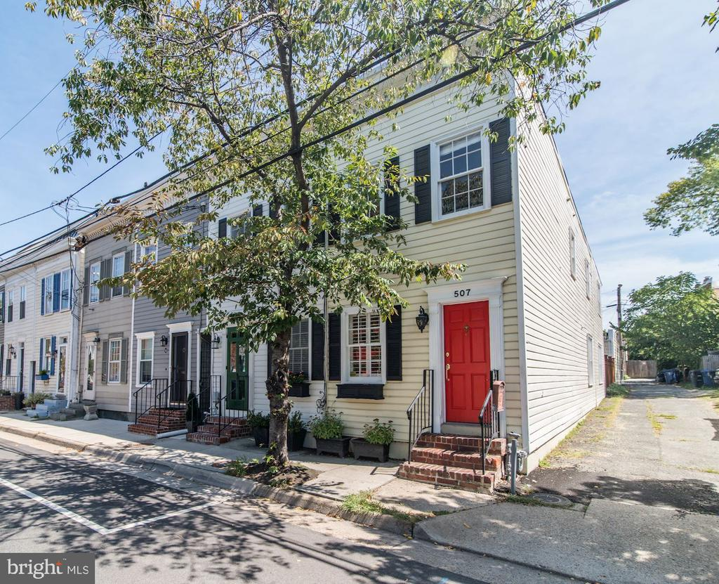 Super-charming and updated 3 BR, 2.5 bath end-unit townhome with detached garage in historic Old Town Alexandria! Spacious, light and bright throughout, this adorable home packs a big punch with over 1,390 SF. The main level of this home features gorgeous hardwood floors, a cozy LR with built-ins and wood-burning fireplace, and a well-appointed DR with chair-rail, crown molding and plantation shutters. The updated, chef-worthy kitchen boasts a center island with breakfast counter, a 6-burner cooktop, range hood, granite countertops, under-cabinet lights, and stainless steel appliances. Guests will also appreciate the all-important, renovated, main-level powder room! Morning sunlight pours through the glass French doors that lead to a fantastic, 22 x 12, fully-fenced brick patio and rare, detached 1-car garage. The upper level features an en-suite Master BR with pretty views and tons of natural light. Bedroom 2 could easily double as a home-office or den with dual closets and hardwood floors. Bedroom 3, also with dual closets, features built-in bookshelves and clever storage options. With a furnace and A/C unit less than 1 year old, updates throughout, and fresh exterior paint, this townhome in the heart of it all is truly turn-key ready! Only 6 blocks to Braddock Metro, 1.8 miles to Amazon HQ2, and just minutes to DC, Pentagon & Reagan Airport. The shops, parks, restaurants and night-life of Old Town Alexandria await you!