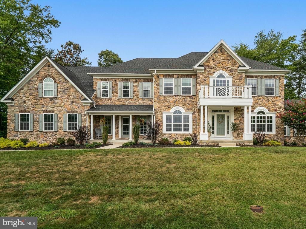 Be in this home to host the holiday festivities this year!!!Beautiful true 5 bedroom home complete with 5 full baths on a quiet dead-end street! All the finishes you would expect in this gorgeous home plus more with THE BEST VIEW in the neighborhood.  View from front porch is straight down the 3rd fairway! Hardwood floors throughout! Complete with conservatory and breakfast room bump outs. Truly a gem in this community that includes a main level bedroom and full bath. Second floor has 4 bedrooms and 3 full baths. Master bedroom is completed by an office/sitting area that looks down the 3rd fairway. Dual closets, dual sinks and dual shower heads finish off the master suite to include heated floors in the bathroom. Fully Finished basement with theatre room, bonus room and full bath! The home was also built with 600 amp commercial electric which allows for extensive lighting and plenty left for all of your future electrical needs. Massive 3 car garage, wooded lot, extra large parking pad. SO much to list~ The privacy and view make this home stand out! Be the envy of every golfer~ the home with the View can be yours!