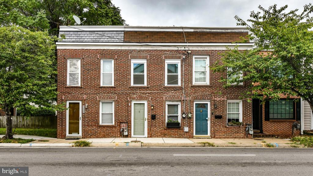 $20k price reduction! Open house cancelled 10/6/19! Charm and location! This sweet rowhouse has all of the special details you expect in an Old Town gem.  Hardwoods, wainscoting, crown moldings, built-ins, classic marble bathrooms, and a beautiful galley kitchen.  The back patio draws you in for daily cups of coffee or entertaining.  1.5 year old Roof and sound proofed front door and front bedroom windows.  Large walk-in closet has been customized in master bedroom. Enjoy the bustling life on N. Henry Street!  Walk to metro or bus, tons of local boutique gyms, Sugar Shack Donuts, coffee spots, community, and delicious restaurants just to name a few neighborhood amenities.  Stroll down across Washington Street and enjoy King Street scenery and waterfront.