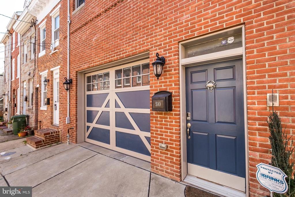 1-of-a-kind 20ft+ wide Garage Town Home on quiet street in Fells Point!  2700sqft+! Spacious main-level includes upgraded & beautiful eat-in kitchen w/granite island, huge Living room & dining room with wet bar, powder room & 1 of 2 decks. Enjoy a gourmet kitchen with huge kitchen island (seating for 6+) and double pantries. 3 bedrooms spacious bedrooms with great closet space, 3 full spa-like baths, Two-person shower in master bathroom, hardwoods throughout, on-demand hot water, intercom, neutral paint colors. Enjoy in floor heat in lower level bedroom and bathroom. 2 zone HVAC. Huge & spacious garage with option for additional garage space next door! Two large outdoor decks with Trex decking. New roof in 2018. Enjoy whole house security system and wifi connectivity/monitoring: four exterior cameras, electronic keypad, etc. The kitchen cabinets (two-tone) and backsplash were updated in 2019. Tons of storage space on all levels and large walk-in closets in two bedrooms. You cannot find a better home with excellent walkability to everything! This meticulously maintained & freshly painted home is a must see!