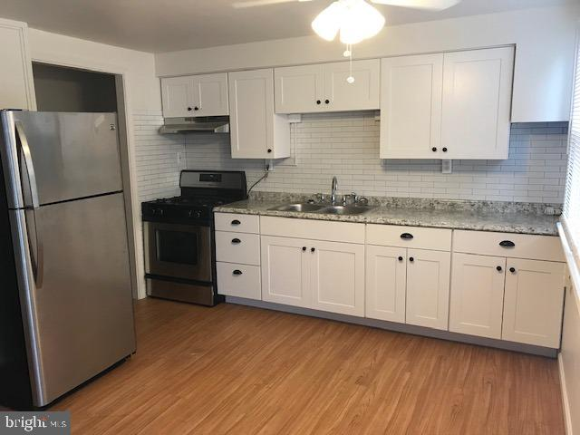 Your remodeled and updated home awaits you.  New kitchen with SS appliances, new flooring (laminate downstairs and carpet upstairs), new light fixtures, new tile and vanity in bath, new exterior doors, fresh paint and more!