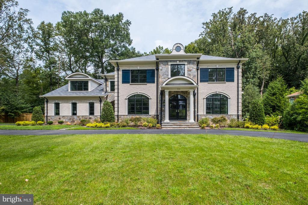 New Home below $3M in Langley Forest/River Oaks on a 1 acre lot. (Lot is worth $1.4M). This stone and brick masterpiece with black-framed windows and circular driveway. Just inside the Beltway, a perfect commuter location. One light to DC, 15 minutes to the Kennedy Center, 30 minutes to the White House, Reagan and Dulles airports. As you enter the home you find exquisite molding, one of Middleburg Associates~ many distinctive details that make this builder~s homes so highly sought-after. The Premium Select Oak Hardwood floors are finished so smooth and the lighting is straight out of Architectural Digest. The library with paneled molding and built in bookcases are befitting a king. The kitchen as well looks like it jumped out of the pages of Luxury Homes magazine with Wolf and Sub-Zero appliances, white perimeter cabinets, an almost black finish on the center island cabinetry with true inset doors, all with soft-touch, and top knob pulls, with a mixed-metal hood vent and a 4 inch thick counter on the island. All of this opens to the family room with stone, floor-to-ceiling fireplace and cedar beam ceiling. The staircase is pushed to the rear of the home with wrought iron balusters and wood handrails. Off the back is a rear covered veranda with slate flooring and large composite deck across the back of the home. The large mudroom with cubbies for the kids' gear and a family entrance are a welcomed feature for most families. There is a luxury master suite on the upper level that has a fireplace between the sitting retreat and the bedroom area, again with lovely lighting, tray ceiling. The master bath features white and gray marble floors, a seamless glass shower with body sprayers, an overhead rain shower head as well as the traditional shower head. The furniture finish cabinets and a free-standing tub complete this luxurious master bath. The built-in custom his and her closets with center island round out the master suite. There are 3 additional bathrooms on the upper level, all done with the same great look, as well as an upper level family room area with built-ins make a great upper level game room or homework area. The fully finished walk-out basement with hardwood flooring has a pub feel. There is a stone wall with a fireplace, a bar with a full-sized refrigerator, dishwasher, great counter tops and 4 pendant lights, a billiard's room, exercise room and an additional bedroom and full bath, making this great entertainment space. The yard can fit a pool and is nice and flat. All this for under one million less than others on the same street!