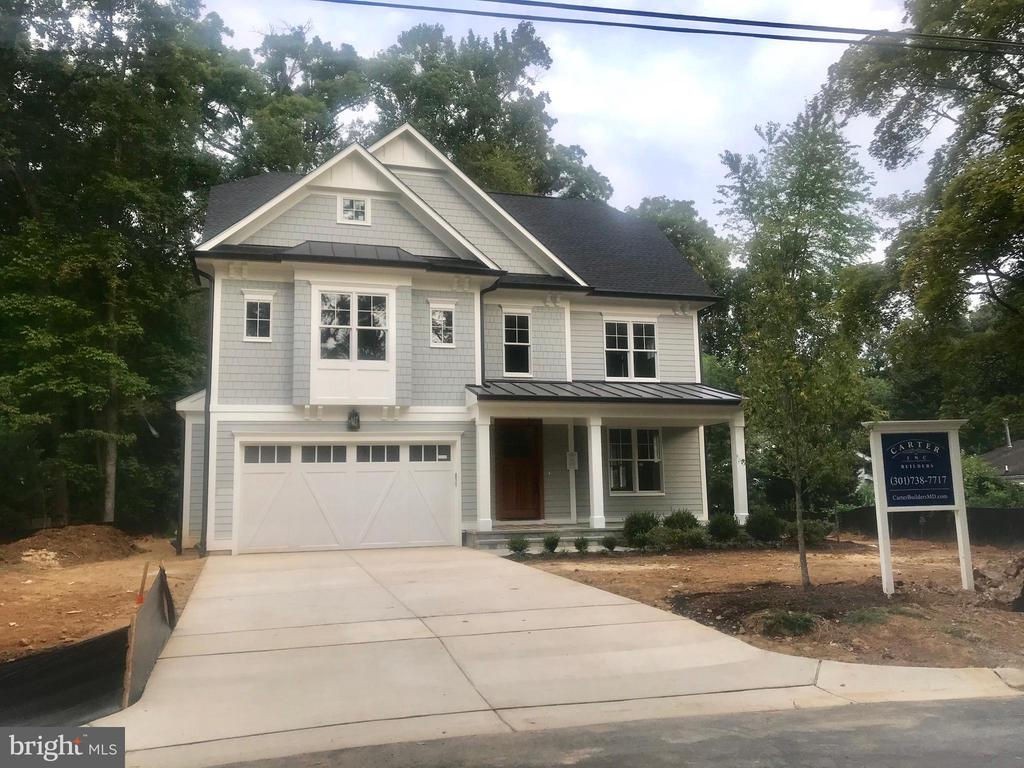 Custom home built by award winning Carter, Inc in Massachusetts Avenue Forest! Rarely available massive 13,741 sq. ft. lot! Private back yard and luxury finishes throughout. Construction completed inside of 30 days but call now for a private showing!