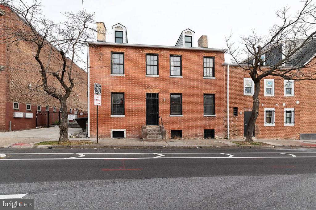 This charming home in the sought-after Seton Hill Historic District is an absolute gem!  So unique, and fully restored.  Hardwood floors throughout (living room and second floor bedrooms have carpet, with restored hardwood beneath).  New kitchen and baths.  Roof and systems replaced in 2017, exterior lead paint professionally removed and brick restored and repointed in 2016.  Built-ins throughout (seller collects vinyl records).  Attention to detail is astounding!  First floor features living room and dining room, each with a decorative fireplace, new kitchen with solid wood cabinets and wood countertops.  First floor full bath is brand new.  Second floor with two bedrooms and a new bath featuring a beautiful soaking tub.  The third floor has two rooms that are finished, with low ceilings.  Could be used as bedrooms, office, storage - you decide.  Basement with exterior entrance, new laundry room, clean and dry.  There is a rear courtyard with privacy wall that is perfect for entertaining.  Location is fantastic - just a short walk to the University of Maryland Baltimore campus and the University of Baltimore, easy walk to the restaurants and activity of Mount Vernon, close to the train station.  Across the street from beautiful St. Mary's Park.  Zoning allows for  residential or commercial use.  Charming, one of a kind in beautiful Seton Hill!