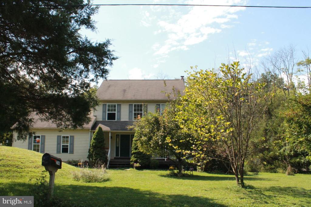 Country colonial on .85 acres in South Coventry....conveniently located to local major arteries....French Creek Elementary, Owen J. Roberts School District.  The first floor layout flows very well, with a formal dining room, and kitchen and breakfast area, going into the family room with wood burning fireplace....master suite with master bath and walk in closet and 2 generously sized spare bedrooms...the walk out basement offers lots of space and is a a true walk out with 2 windows....this space is ready for your finishing touches...the 2 car garage for storage....But, the back yard backs up to the stream, and offers lots of open space!   One year home warranty offered at settlement to the buyer.