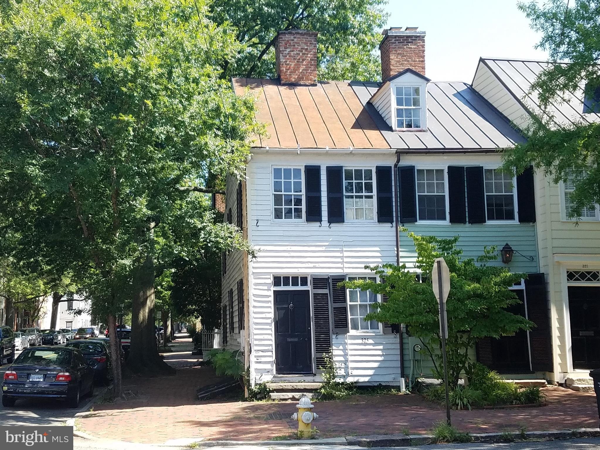 """Rarely available end-unit townhome in Historic Old Town Alexandria!  Originally built in 1800 and sited at the corner of Duke Street and S. Royal Street, walking distance from your favorite retail and dining establishments on King Street in Old Town!  Just three blocks to Alexandria City Hall, and six blocks to reach Waterfront Park, Torpedo Factory, and Chart House Restaurant overlooking the docks and water taxi.  Founders Park offers jogging and bike trails, concerts, events, and spectacular views of sailboats gliding by, airplanes flying overhead, National Harbor across the river, and fireworks on the 4th of July!  Tax records state the property was remodeled in 1972 and is 1,210 square feet on two levels above ground with a fireplace, plus 372 square feet in a basement.  Property is assumed to be in below-average condition and is being sold """"As Is"""".   Best suited for a cash purchaser experienced with renovations, whether an investor or private owner.  The location is in high demand, and the high public visibility of this corner lot makes this a very exciting project for the new buyer."""