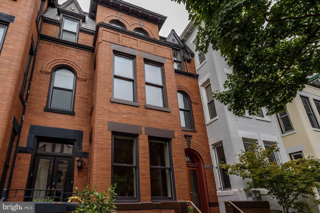 Built in 1900, this beautiful home was extensively restored and completely renovated in 2002. Interior spaces were reconfigured, staircases moved and ceilings raised, to bring in light, openness, and drama. Architectural details such as deep crown moldings, a coffered ceiling, designer lighting and custom built-ins abound. The sky-lit chef~s kitchen features a central island with seating, and view of the patio and fish pond. With 4 bedrooms (one set up as on office) and 3 baths up, there is a lot of flexible space. A handsome roof deck on the second floor has great city views. There is a 2BR unit in the lower level. Mintwood is one of the prettiest and most sought-after streets in Kalorama Triangle. With a ~walk score~ of 96, you are close to the Metro and bus lines, eclectic shops and restaurants as well as nature in Rock Creek Park.