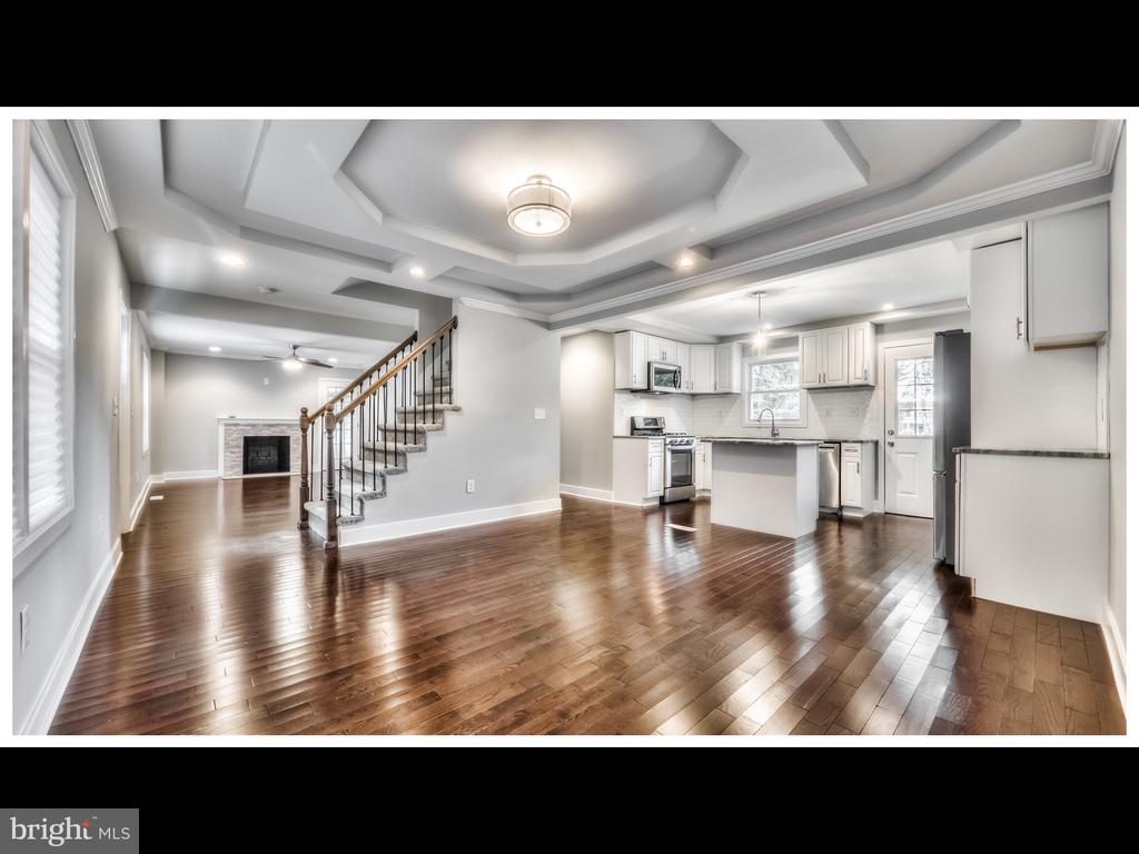 COME SEE THIS BEAUTIFULLY RENOVATED FROM TOP TO BOTTOM 4 BEDROOM/4 FULL BATHROOMS.BRAND NEW GRANITE COUNTERTOPS, STAINLESS STEEL APPLIANCES. BRAND NEW GLEAMIN HARDWOOD FLOORS. MASTER SUITE AND JUNIOR SUITE.FINISHED BASEMENT WITH WET BAR. HUGE BACKYARD, REMODELED SUNROOM, CARPORT.