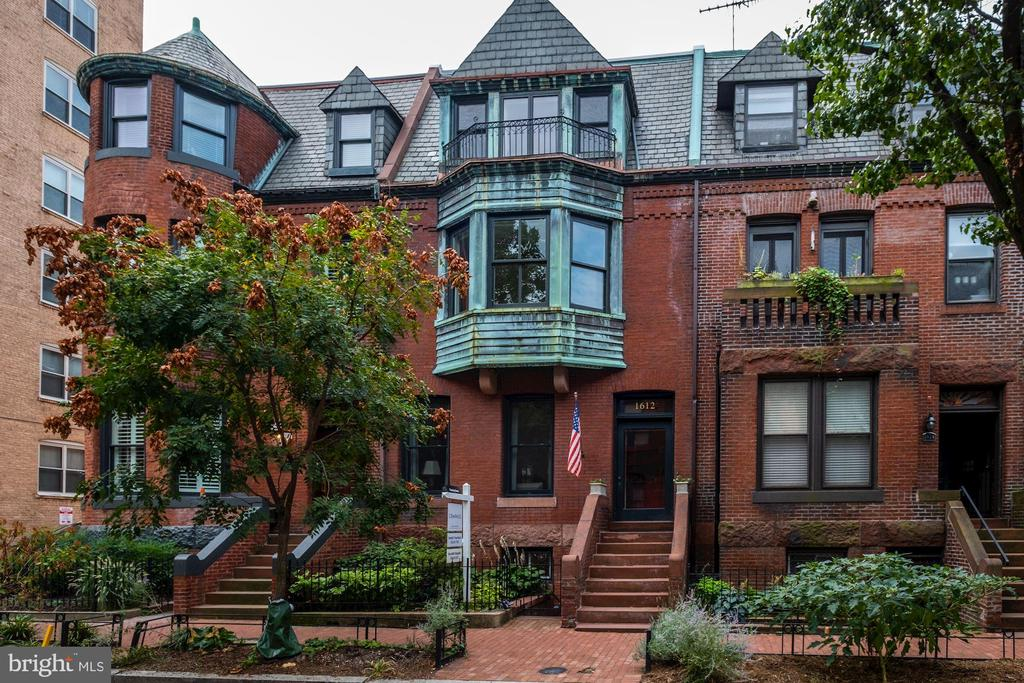 Come see this historic Dupont row house. Built in 1885 by renowned architect Harvey L Page, and updated with a tasteful blend of historic details and modern amenities, this elegant row home offers four levels of spacious living in the heart of the city. The grand 3-story center atrium floods the house with light. The interplay of old world character and contemporary updates includes elegant features such as a vintage front door and entry, exposed brick walls and multiple fireplaces, alongside renovated bathrooms and a hidden loft space. This pristine home presents an expansive floor plan that includes an open living room to dining room area, breakfast room, plus a fully finished in-law suite, with two forms of egress. A serene backyard perfect for entertaining plus the detached 2-car garage, completes this home situated on the most coveted block in Dupont Circle.