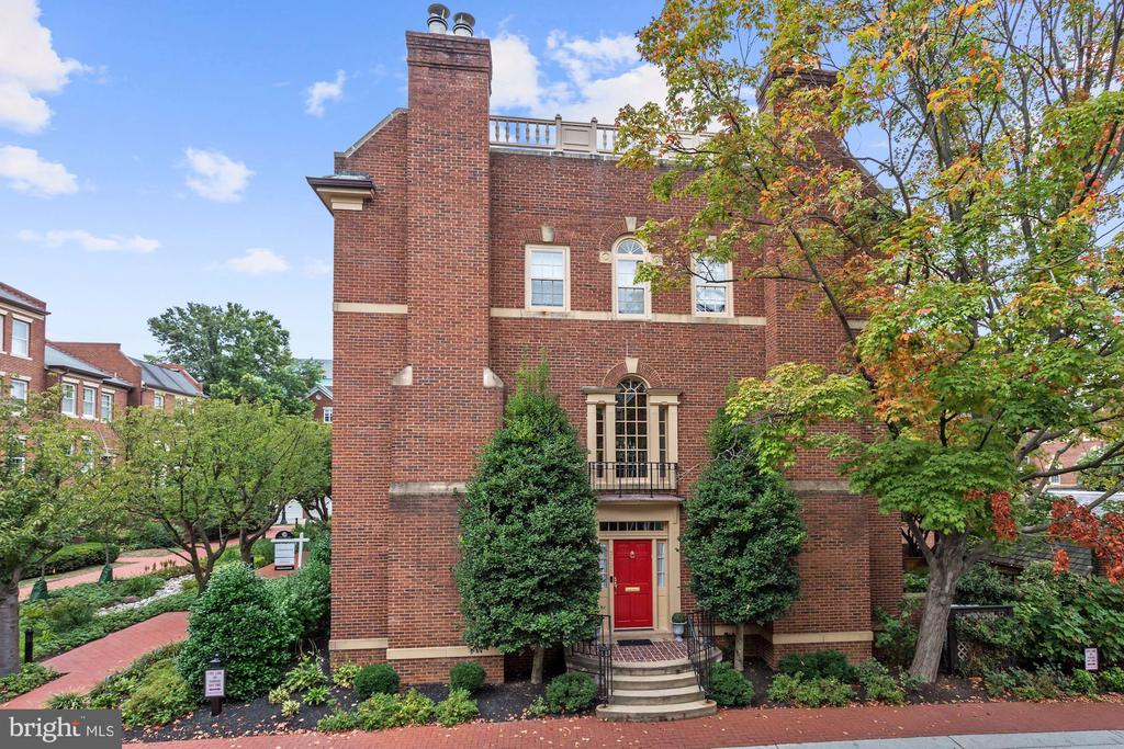 Open Sunday Nov. 17th from 2-4pm! Welcome to this classic Cloisters END UNIT ELEVATOR townhome with 2 car garage and entertaining patio! LIGHT filled floorplan with high ceilings and hardwood floors throughout. Three bedrooms and four full baths, two half baths. This home is in the original Donohoe built section Cloisters One. Master suite with his and her baths. Library with entertaining bar and second powder room. Spacious formal living room and dining rooms with fireplaces in each. Large open kitchen with table space and family room space plus fireplace.  A wonderful inviting floorplan plus a real two car garage in sought after Georgetown! Just a few blocks from Georgetown University and Hospital! Easy access to shopping and restaurants too. 15 minutes to Reagan Airport!
