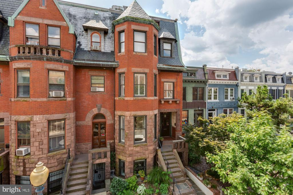 Victorian Charm meets modern luxury! A beautiful 2nd level condo situated in a historic Dupont Circle mansion that offers unique privacy and accessibility -- no shared space with residents, no elevator, nor condo fees. This gorgeous 1,650 s.f. offering is comprised of 2 bedroom/2 bathroom on two floors and includes desirable outdoor space and parking for two cars. Perfectly immersed in the historic details of this home are the kitchen and baths --- the modern kitchen offers custom cabinetry, stainless steel appliances, granite counters, while the beautifully updated baths truly stun! Outside, a large deck in back is perfect for outdoor entertaining, and convenient parking for two cars is also located in the rear (including one garage space). Important to note is that when the mansion was converted to condos, the developer took special care to retain as much of the original historic detailing, from the moldings, wood floors and pocket doors, to the wood burning fireplace and nearly 11' ceilings -- the attention to detail is superb! Walk to metro and all the amazing conveniences of DuPont Circle await your buyer!