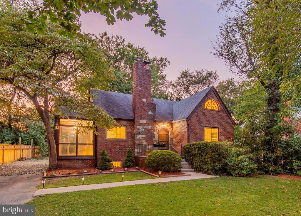 Step inside this stunning all brick Tudor-style home in Silver Spring's coveted Indian Spring Hills neighborhood. As you enter, a large family room with hardwood floors and a brick-wood burning fireplace greets you. A nearby side porch with sliding glass doors and walls of windows allows you to watch the seasons change during morning coffee or an evening glass of wine. The galley-style kitchen offers plenty of storage space and access to an expansive backyard surrounded by mature landscape. Two main level bedrooms share an updated full bath. Upstairs, finished attic space can be transformed into a private master~s retreat or home office. A fully finished lower level is bursting with possibilities for additional recreation space or a home gym. Excellent location on well-established street minutes from the I-495 Beltway, vibrant downtown Silver Spring, future Metro Purple line as well as Sligo Creek Park. Welcome home!  **Awesome Features**Stunning all-brick Tudor home in established neighborhood**Spacious family room with hardwood floors and wood-burning fireplace**All-season side porch with sliding glass doors**Designated dining room**Galley style kitchen with plenty of cabinetry and backyard access**Two main level bedrooms with updated full bath**Finished attic for potential master bedroom or home office**Fully finished lower level with separate room for possible gym**Large backyard with mature landscaping**Commuter~s dream; jump on Beltway in mere minutes**Excitement and entertainment in nearby Downtown Silver Spring**MUST SEE!!!!