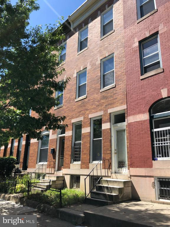 This 3-story Charles Village rowhouse is in a prime location within blocks of Johns Hopkins University and R-House. Here's an opportunity to renovate and make this all brick rowhouse yours. Currently divided into multiple units: three 1-bedroom/1-bathroom units and one rooming unit. Convert the property  back to a single family home. This property is not licensed as a multi-family unit. Fire escape required for 3rd floor unit. Sold As Is. Needs work. Cash or conventional financing.