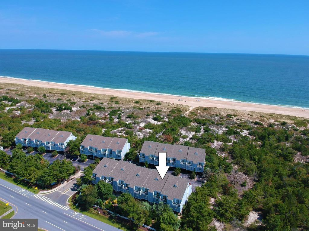 This beautiful coastal style townhome is located only steps to the beach, just one off the oceanfront in a private gated community in North Bethany. Offering an open floorplan on the main living level featuring a beautiful kitchen with updated cabinetry and adjoining dining area that flows into the living room and opens to a sizable porch creating the perfect space for entertaining. Plenty of room for friends and family with 4 spacious bedrooms including a master suite with updated bathroom, and multiple decks and porches on every level. Additional conveniences include a brand new HVAC in 2019, covered parking under the home, outside shower, and additional storage space for all of your beach supplies. Offered fully furnished this home is ready to be enjoyed or a great investment property with a proven rental history. Ideally located just south of the Indian River inlet with nearby marina, state parks, and close to some of the areas best restaurants.