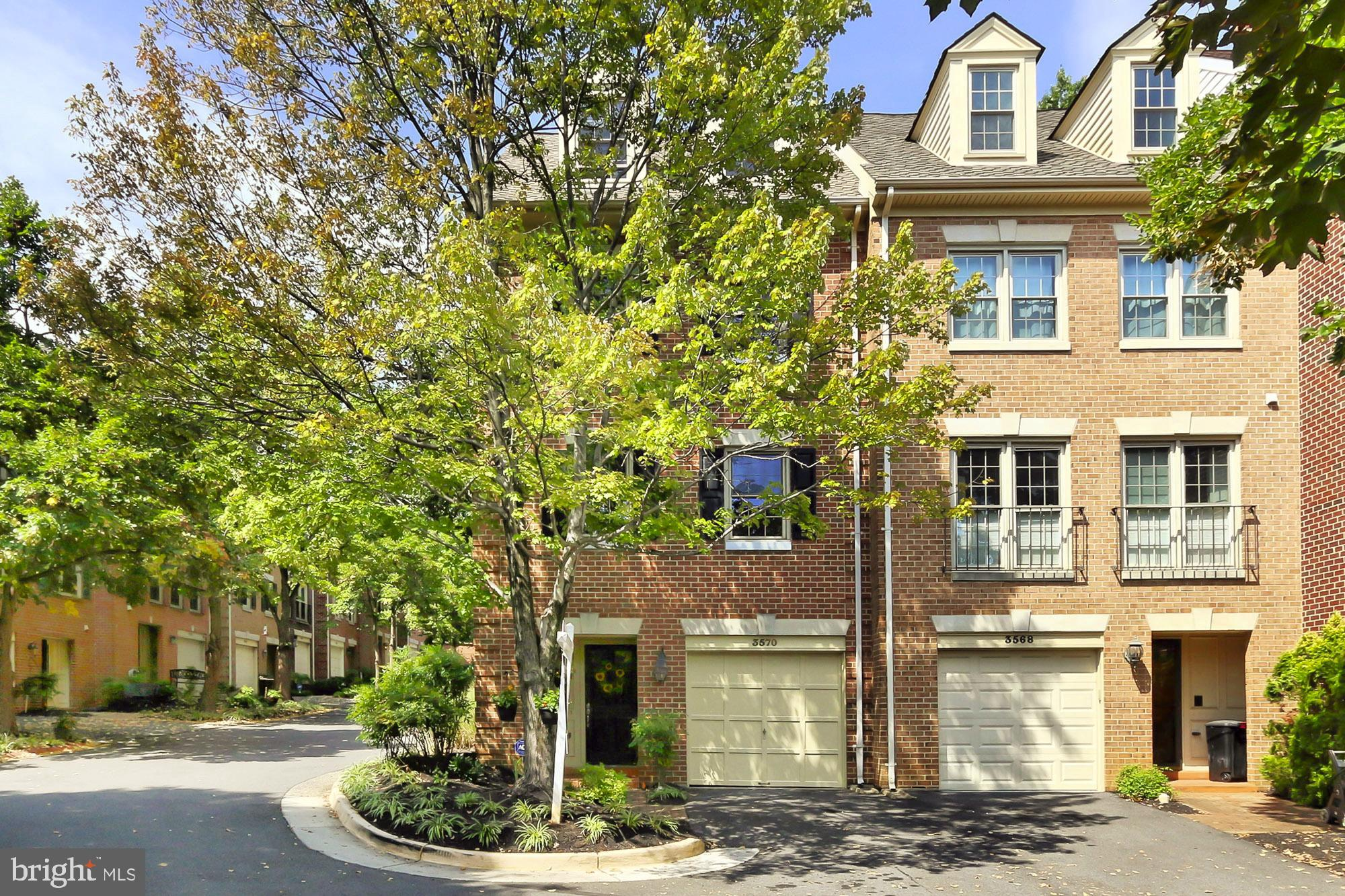 Nestled in a small enclave of luxury townhomes in the Skyline Village neighborhood, this 3 bedroom, 2 full and 2 half bath end-unit townhome is infused with countless designer details and is updated with the modern luxuries that home buyers seek. An all brick exterior, 1-car garage, courtyard-style fenced-in yard, and vibrant landscaping are only some of the fine features that make this home so exquisite. Decorative moldings, modern lighting, fresh professional paint, extensive built-in shelving, finished lower level, and updated kitchen and baths reveal expert craftsmanship, while the abundance of windows bathe every room with natural light.New luxury hardwood-style vinyl flooring and decorative moldings in the foyer welcome you home. Ascend the stairs to the spacious sunken living room featuring rich hardwoods, custom crown molding, and a sliding glass door opening to a freshly painted deck with descending steps to a fenced-in yard~seamlessly blending indoor and outdoor entertaining or simple relaxation. Back inside, the dining room is highlighted by chair rail and a frosted-glass chandelier adding a distinctly tailored feel. The gourmet kitchen will please the modern chef with striking granite countertops, traditional and glass-front maple cabinetry, decorative backsplash, stone flooring, and stainless steel appliances including a gas range and built-in microwave. A center island with pendant lights provides bar-style seating and introduces the breakfast area that harbors ample table space and additional cabinetry, as a powder room updated to perfection complements the main level.Upstairs, the gracious owner~s suite boasts plush carpet, a wall of reach-in closets, and a luxurious en suite bath updated with dual vanities, sumptuous soaking tub, frameless shower, and spa-toned tile with decorative inlay. Down the hall, two bright and spacious bedrooms each enjoy easy access to the beautifully appointed hall bath. Fine craftsmanship continues in the lower level recr