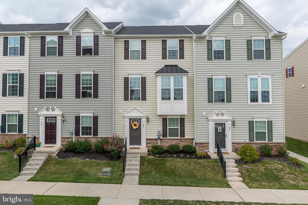 Exquisite, well cared for, 3-bedroom, 2.5 bath townhome in award winning Owen J. Roberts School District and sought-after Washington Square Community.  This 3-year young home has many of the available builder upgrades and gives you the feeling that you are entering new construction. There are three accesses into the home - Front Door, Back Door and the Garage.  The rear entrance allows garage parking, 2-car driveway parking in addition to extra spaces for guests.  The rear additional space is currently being designed and proposed to house a playground with walking paths.  Entering the home from the rear, brings you through the bonus room ~ use your imagination:  office, rec room, game room?  Walking through the hall you will find the half bath, access to the garage and the finished family room.  If you enter the front door you will enter the tiled foyer, walk up the stately staircase to the main level.  This level has beautiful hardwood floors throughout, open floor plan, and floods of natural light.  To the left is the formal dining area which flows into the gourmet kitchen which has all granite, including an island for seating and another section of counter space with another seating area, stainless steel appliances, double sink, pantry, gas cooking, and tall espresso cabinets.  To the right you will find the spacious great/living room ~ great for entertaining, also housing the Nest Thermostat.  The third floor features the Master Suite with walk in closet, Master Bath with an over-sized stall tiled shower and double sinks, two additional bedrooms, the washer and dryer are conveniently on this floor as well. The home has a full security system with door chime in addition a sprinkler system. The Community has marked the areas for Street Lights in the front and in the back.  At the entry to the development off Bridge Street, they are building a commercial building that is slated to be a Duckling Day Care Center. This property has been priced according, to allow the 