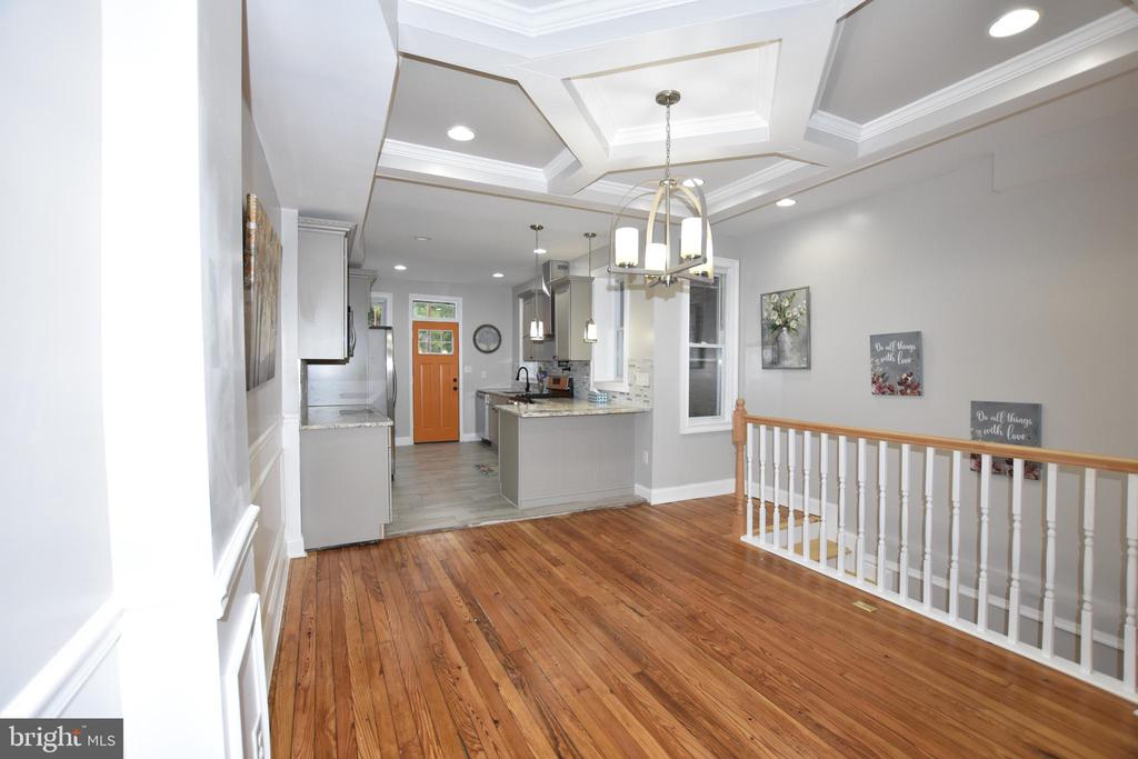 Gorgeous new renovation with permits. New electrical, plumbing, New HVAC with New Duct work. Gorgeous spacious kitchen with pantry.  Restored original wood floor throughout, fully finished lower level with sump pump, Rear deck, and gated parking path.
