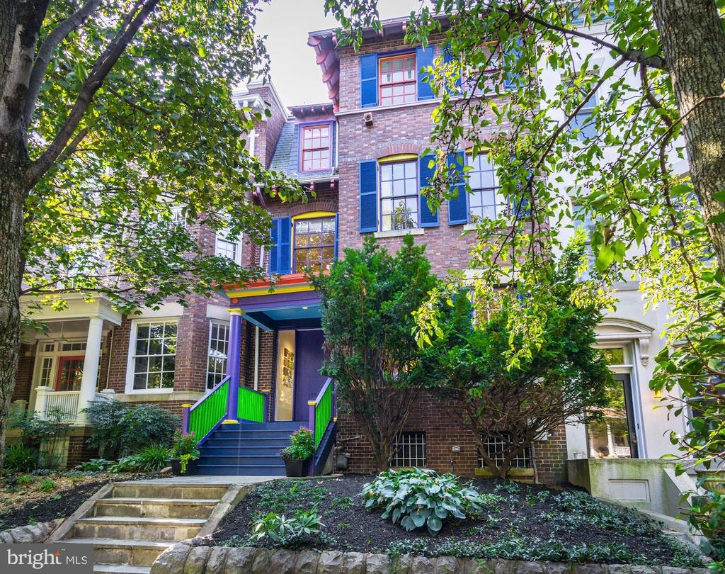 """This sophisticated Victorian """"painted lady"""" is sited on one of Mount Pleasants most iconic and coveted blocks, a bucolic promenade meandering through a dense tree canopy past lovingly landscaped gardens. Built in 1909, the original craftsmanship and detailing is now embellished with unique, modern architectural enhancements by past owner Sam Gilliam, a renowned local abstract artist known for his use of bold colors. The elevated siting provides 4 finished levels of sunlit living, with the perfect flow for both indoor and outdoor entertaining. The chefs kitchen has been newly renovated to compliment the main floor modern narrative, and leads to an airy sitting porch over-looking a deep rear yard and expansive deck. It is rare opportunity to find these grand, neighborhood homes with south facing gardens, spacious garages, and sited only a stroll to myriad neighborhood shopping and restaurant venues, Metro and all the beauty of Rock Creek Park and National Zoo.  Truly the perfect choice for todays most discriminating urban buyer who desires location, quality and true value."""