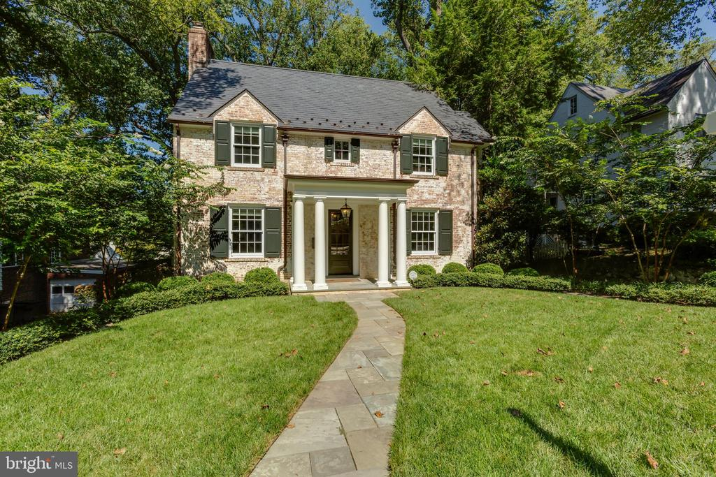 Located in idyllic Spring Valley, this grand home has been meticulously renovated, expanded and finished with custom details throughout. The sun-filled property offers gracious living on four finished levels. The open concept main floor, complete with high ceilings, hardwood floors and custom built-ins, includes a formal living room with wood-burning fireplace, an adjoining family room with gas fireplace, and a proper dining room. The flawless gourmet kitchen features Carrera marble countertops, a vast island, oversized appliances and a full butler's pantry. Upstairs, the luxurious master suite provides a spacious dressing room and a spa-like bathroom complete with a steam shower and soaking tub. Every room of the property features custom millwork and cabinetry, crown moldings, recessed lighting, integrated audio systems, and capacious storage. The fully finished lower level offers additional living space, entry to two attached garages and a delightful mud-room with exterior access. A blue-stone patio, raised deck and sprawling tree-lined backyard provides ample space for outdoor entertaining. A new slate roof and copper gutters complete the offering. 4943 Quebec Street NW is situated near several parks and numerous shopping and dining venues.