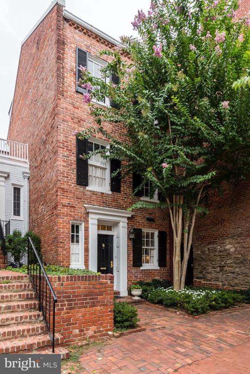 Utterly charming and wonderfully renovated Federal-style house with terrific East-Village location. 2-4 Bedrooms, depending on how you cut it. Gorgeous, deep garden. Options for a luxurious master suite. Views of Georgetown and the tree-tops.