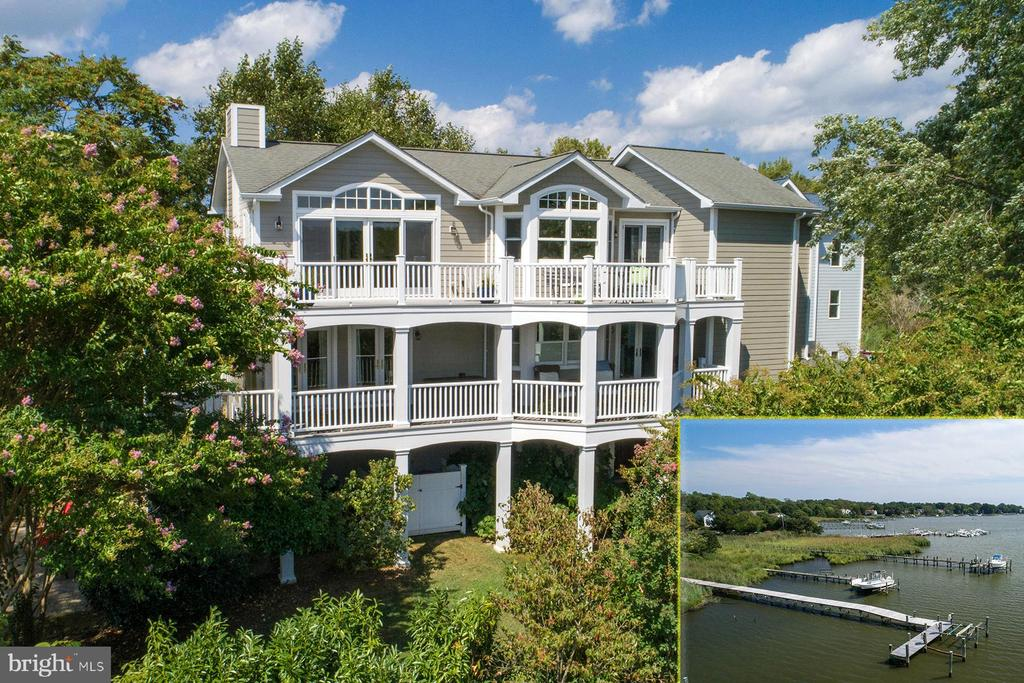 1306 Harbor Road is a gorgeous craftsman style waterfront home on a picturesque lot in Oyster Harbor overlooking Fishing Creek.~ With three levels of living space, multiple decks, and walls of glass throughout, this home offers the best of waterfront living in a convenient location.~ By boat, the private pier gives quick access to the Chesapeake Bay. By land, you are just minutes to major commute routes into D.C. and Baltimore, shopping, restaurants, and downtown Annapolis.The layout of this home is perfect for maximizing the views.~ The main living space is on the top level and is easily accessed by the gracious staircase or the elevator.~ As you arrive to the top landing, you are greeted by the bright and open feel, the natural light that floods the space, and views down Fishing Creek.~ The brand-new kitchen has top-of-the-line finishes with a large center island that includes a breakfast bar. There~s stunning white and gray cabinetry, Silestone counters, glass tile backsplash, and stainless steel appliances that include a Sub-Zero refrigerator and a Wolf gas cooktop. The kitchen faces the dining space that flows seamlessly into the living room.~ The tile accented gas fireplace, custom window seats, and soaring wood-paneled ceilings make this a perfect place to enjoy the water views all year round.~ This space also has access to one of the huge waterside decks.~ Down the hall is a lovely room that would make a great music room, home office, or playroom. There is also a full bathroom on this level.The bedroom level of this home has a huge master suite with a luxurious bathroom that features a magnificent claw-foot tub and two vanities with marble tops. There are two walk-in closets and private access to another waterside deck overlooking Fishing Creek.~ In addition, there are two bedrooms on this level that share a hall bathroom.~ The first level of this home has a family room with access to the waterside patio and a fourth bedroom that would be perfect for guests.
