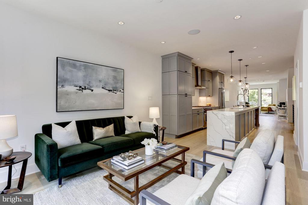 Indulge yourself in this sophisticated and modern, new construction residence! 922 6th Street presents two homes that have been expertly thought-out and finely crafted, defining urban luxury. Residence 1 is a brilliant two-level condominium featuring 3 bedrooms, 2.5 baths, an expansive open floor plan, and a decadent list of designer details throughout.This home has been built with today's discerning resident in mind, complete with a smart floor open plan that seamlessly connects living & dining spaces with a chef's kitchen featuring professional-grade appliances. Complemented by over-sized windows ~bathing the rooms in natural sunlight ~ boasting a convenient half bath & access to the private back deck~the main level truly is the perfect space for entertaining family and friends.Retreat to the lower level, the private area of the residence with comfortable bedrooms and luxurious spa-inspired bathrooms.This home is finished to the highest standards, in the heart the heart of the vibrant H Street corridor! An impressive array of award winning restaurants,boutiques, fitness studios, and services just blocks away. Parking is available for sale.