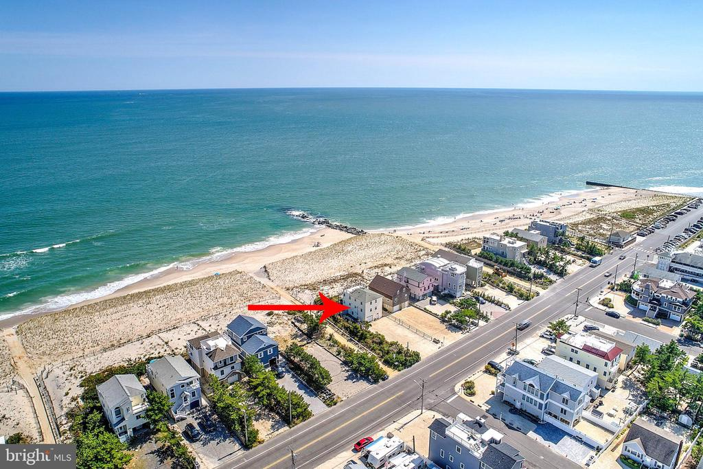 Holgate Oceanfront with 6 bedrooms! Can be a terrific rental property or tear down and build new. Right across the street from the new constructions at Island's End- Call now to see this great oceanfront property.
